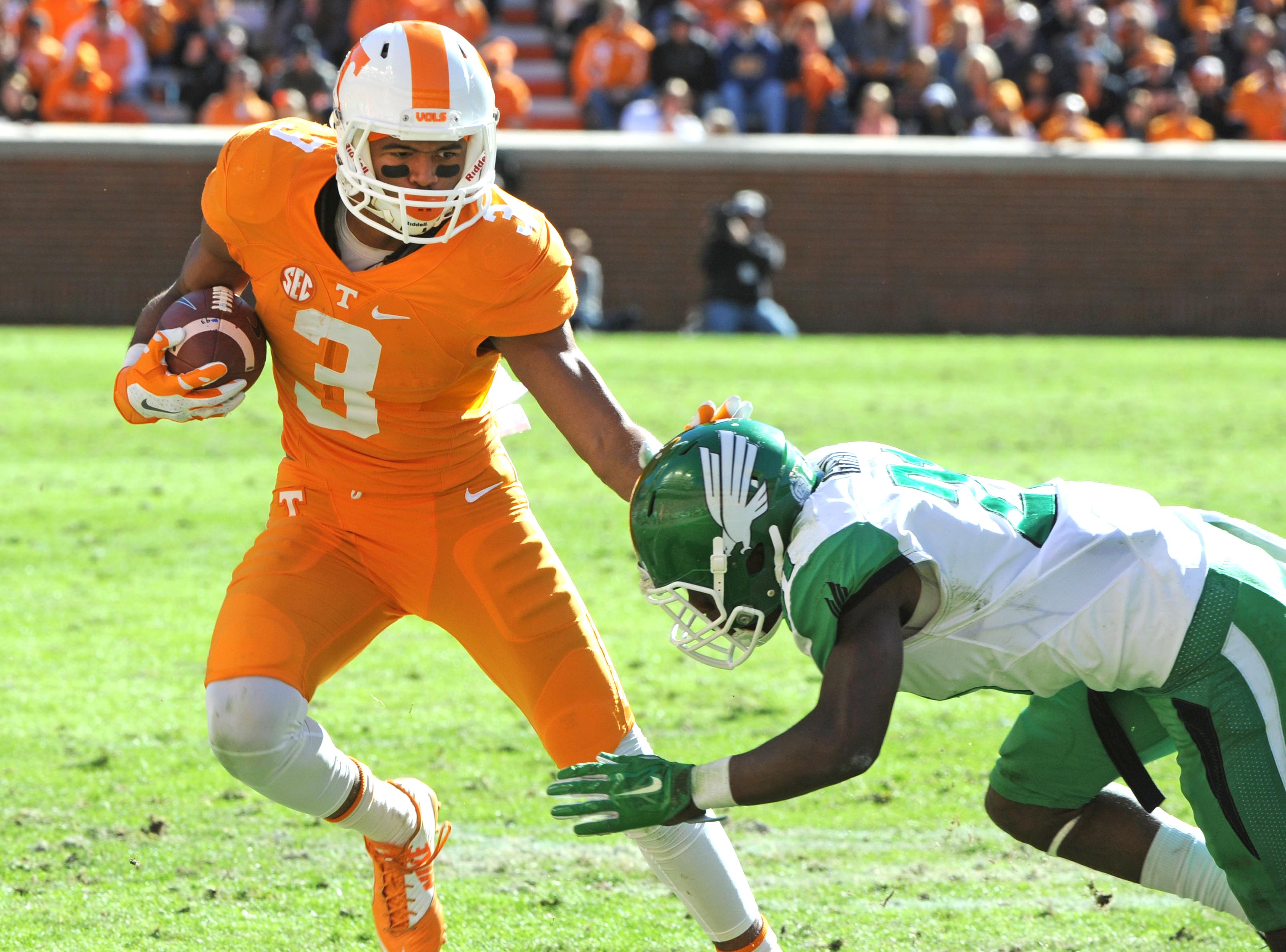 Tennessee wide receiver Josh Malone (3) stiff arms North Texas defensive back James Gray (21) during the first half of an NCAA college football game at Neyland Stadium in Knoxville, Tenn. on Saturday, Nov. 14, 2015. (Michael Patrick/Knoxville News Sentine