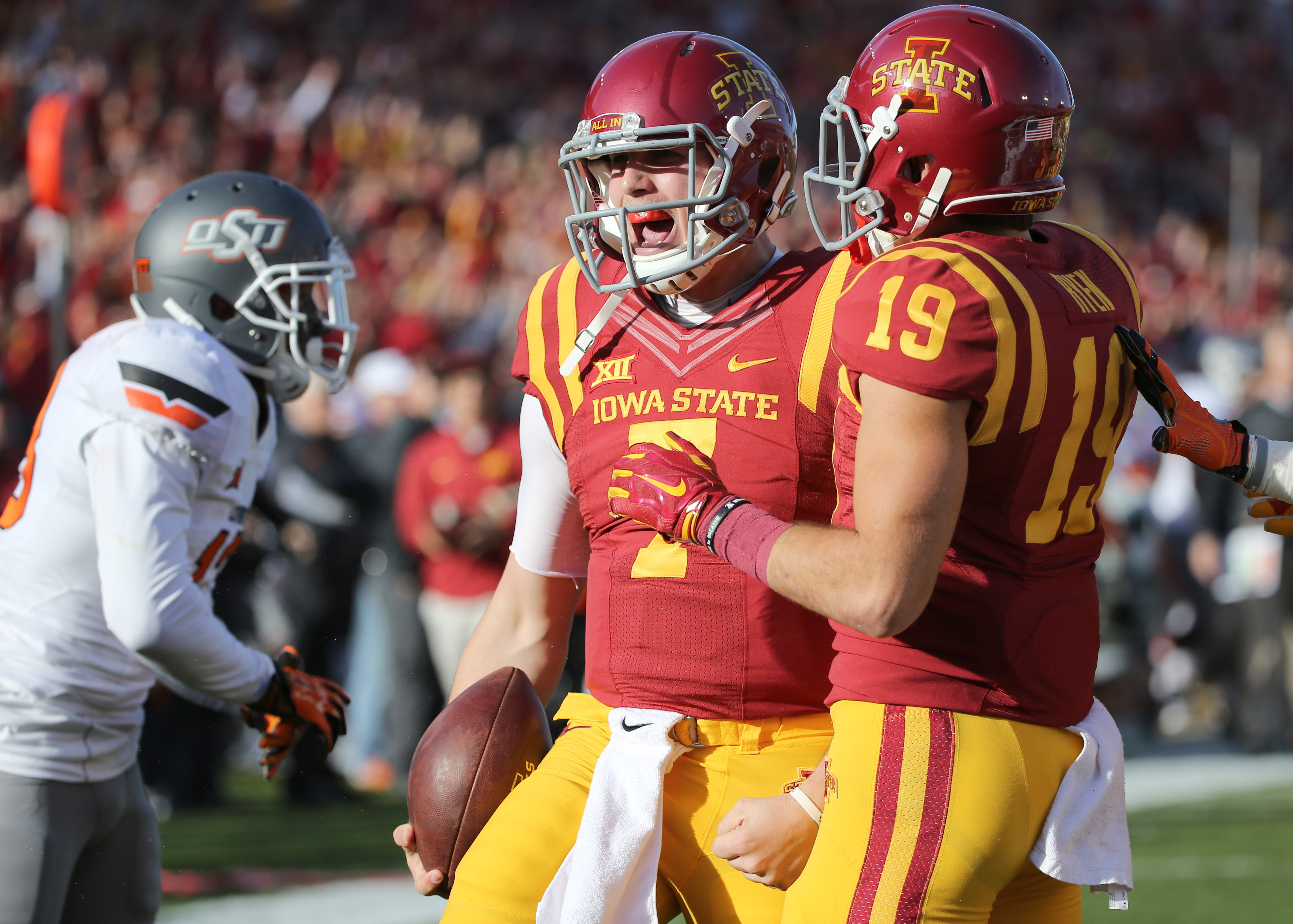 Iowa State quarterback Joel Lanning, center, celebrates with wide receiver Trever Ryen after a touchdown run during the first half of an NCAA college football game against Oklahoma State, Saturday, Nov. 14, 2015, in Ames, Iowa. (AP Photo/Justin Hayworth)