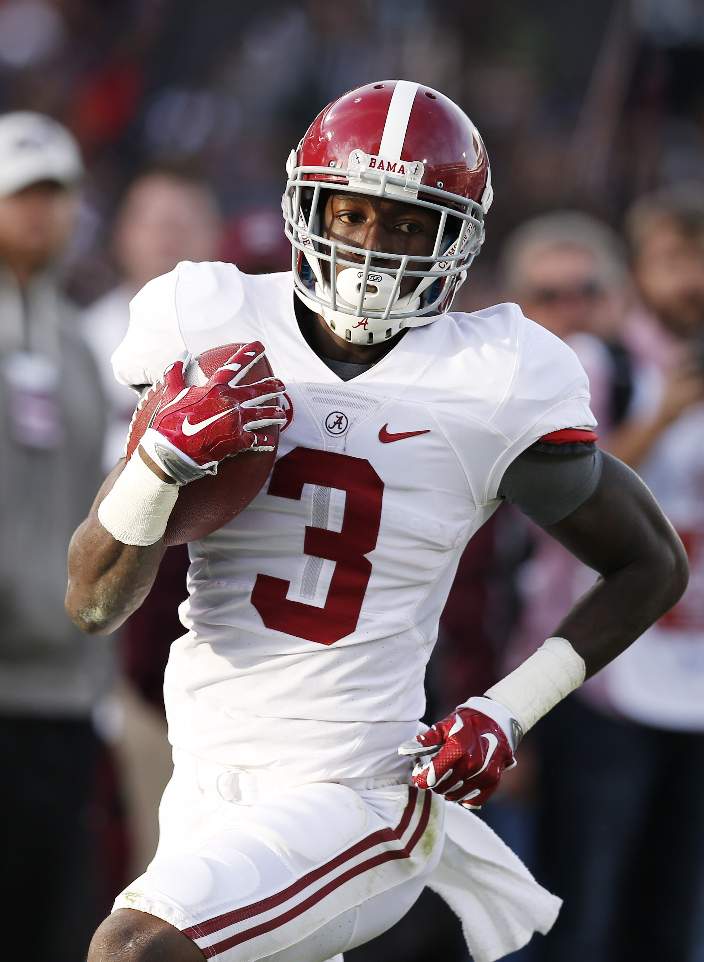 Alabama wide receiver Calvin Ridley (3) scores a touchdown on a 60-yard-pass reception during the first half of an NCAA college football game against Mississippi State in Starkville, Miss., Saturday, Nov. 14, 2015. (AP Photo/Rogelio V. Solis)