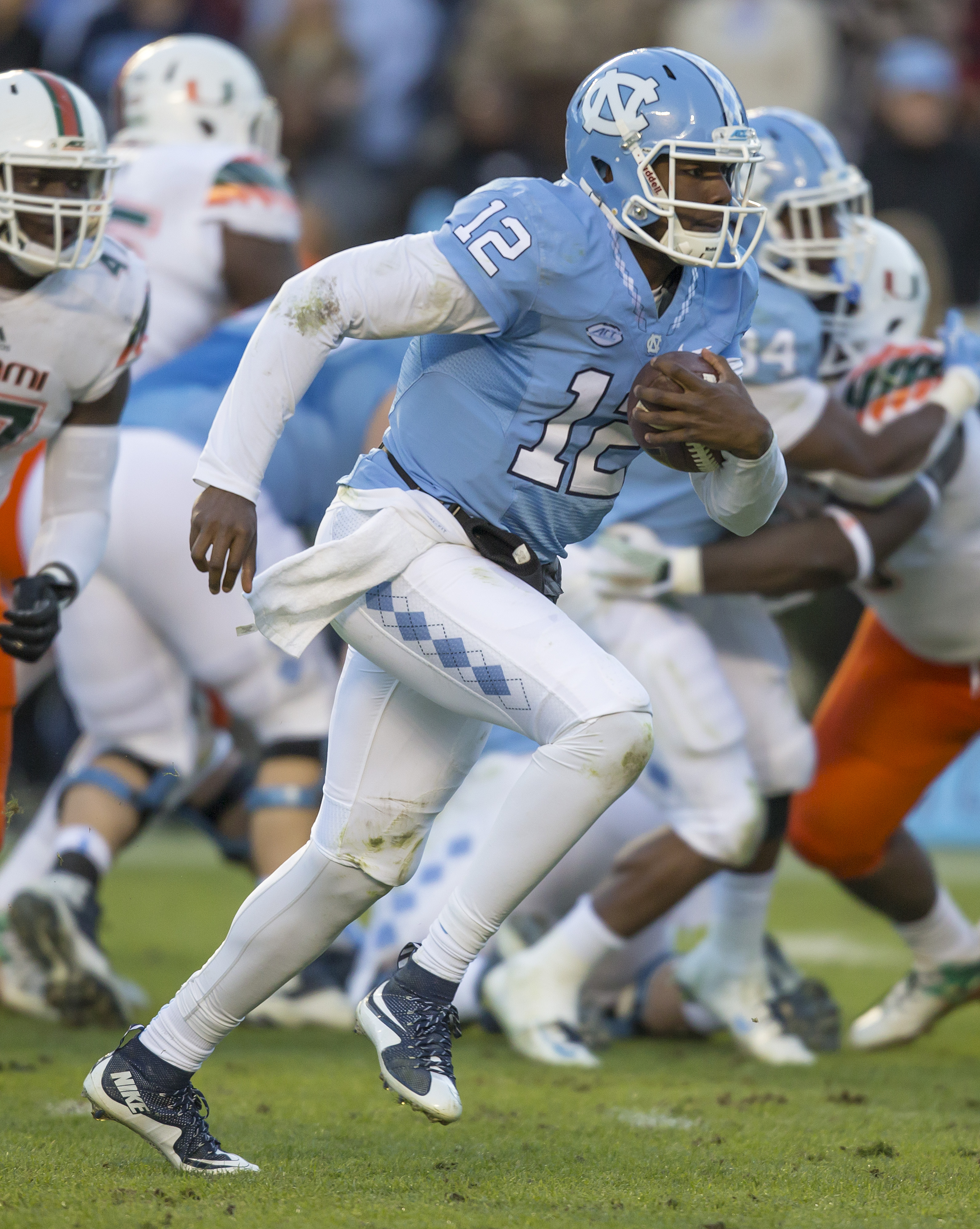 North Carolina quarterback Marquise Williams runs for his second touchdown against Miami during the first half of an NCAA college football game, in Chapel Hill, N.C., Saturday, Nov. 14, 2015. (AP Photo/Rob Brown)