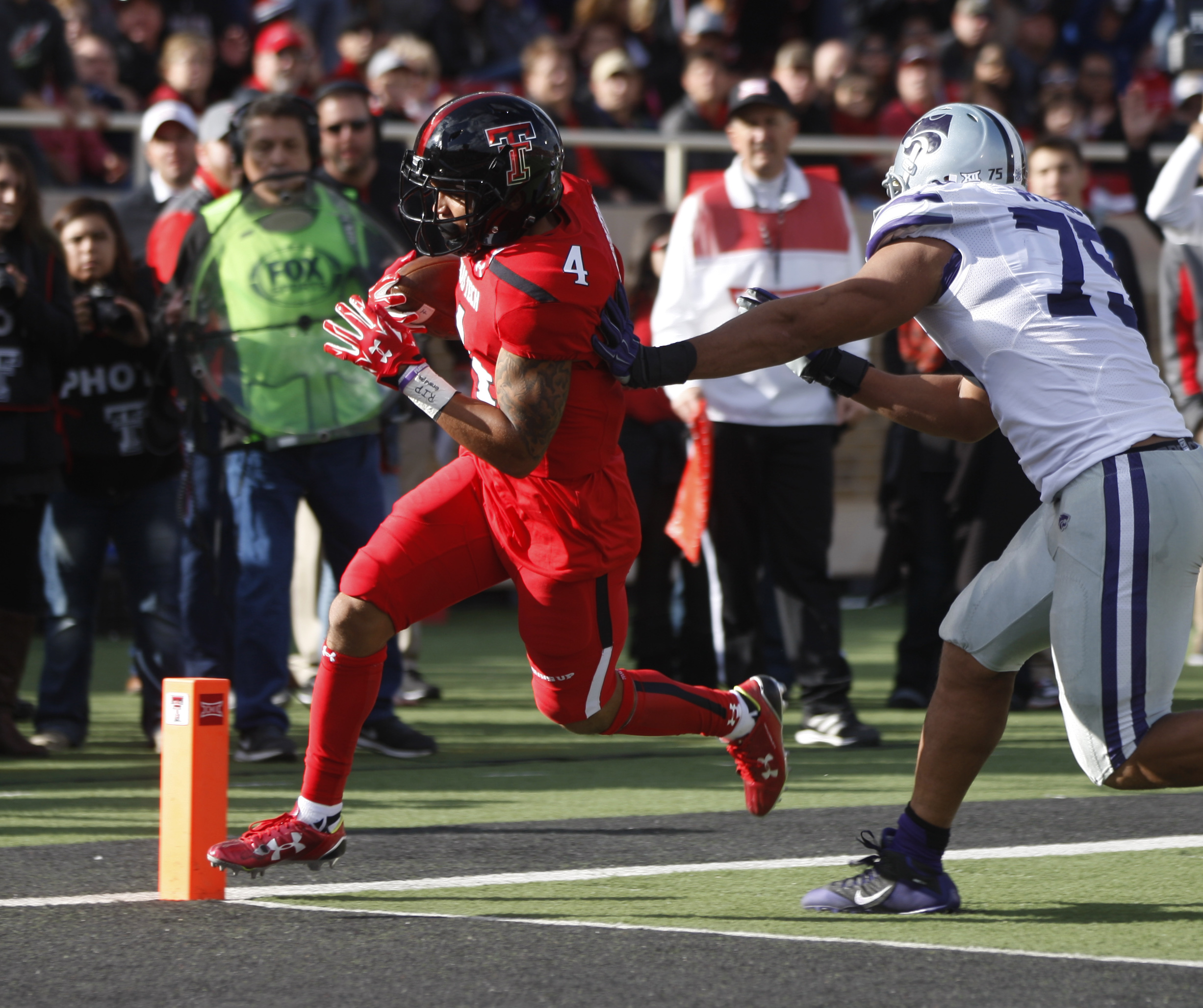 Texas Tech running back Justin Stockton makes a touchdown run during an NCAA college football game against Kansas State, Saturday, Nov. 14, 2015, in Lubbock, Texas. (Mark Rogers/Lubbock Avalanche-Journal via AP) ALL LOCAL TELEVISION OUT; MANDATORY CREDIT