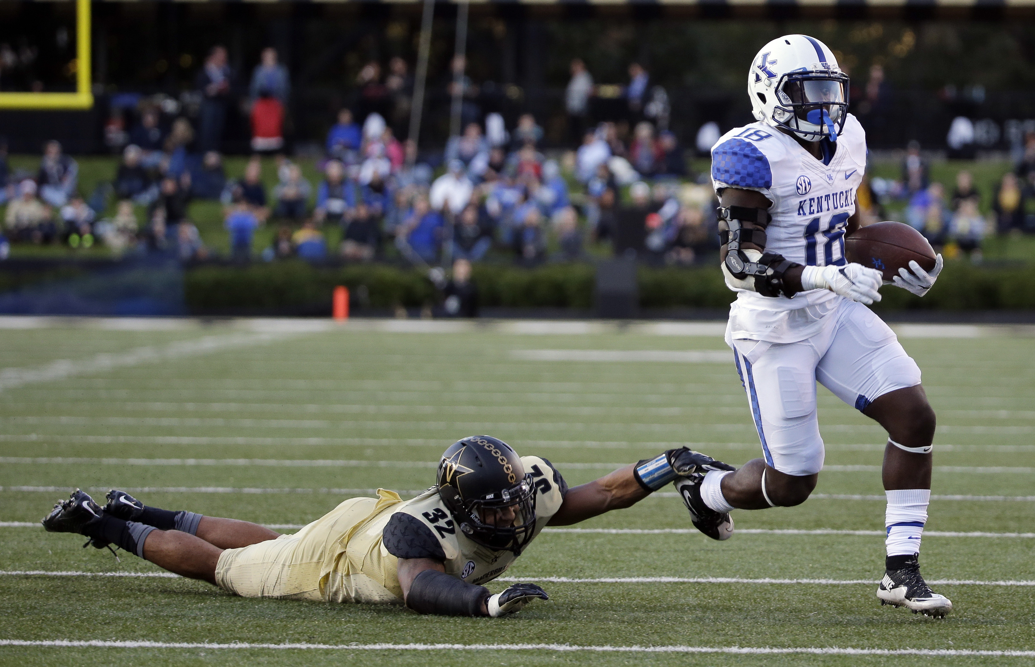 Vanderbilt safety Andrew Williamson (32) makes a one-handed tackle against Kentucky running back Stanley Williams (18) in the first half of an NCAA college football game Saturday, Nov. 14, 2015, in Nashville, Tenn. (AP Photo/Mark Humphrey)