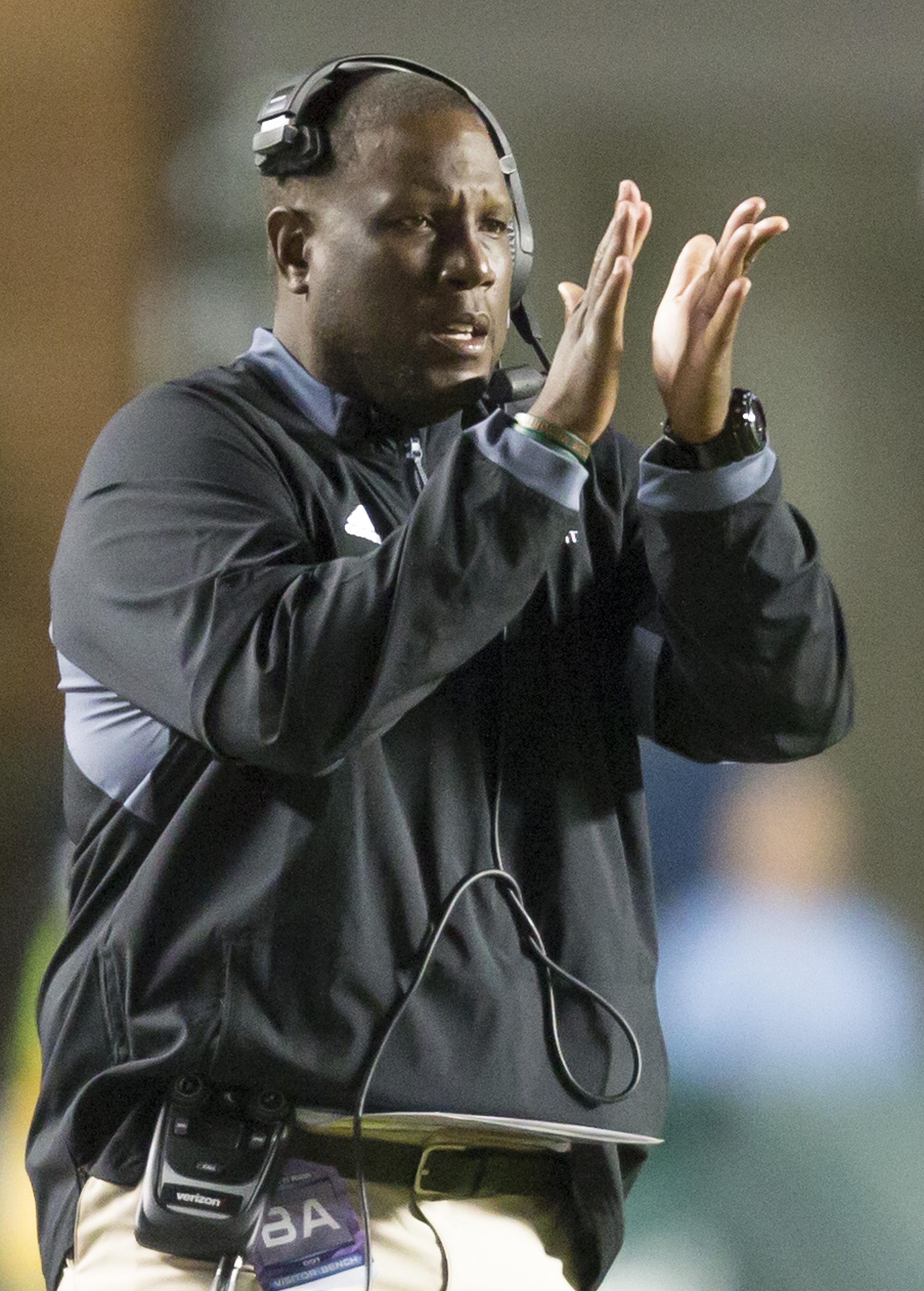 Miami interim head coach Larry Scott encourages his players from the sideline during the second half of an NCAA college football game, in Chapel Hill, N.C., Saturday, Nov. 14, 2015. (AP Photo/Rob Brown)