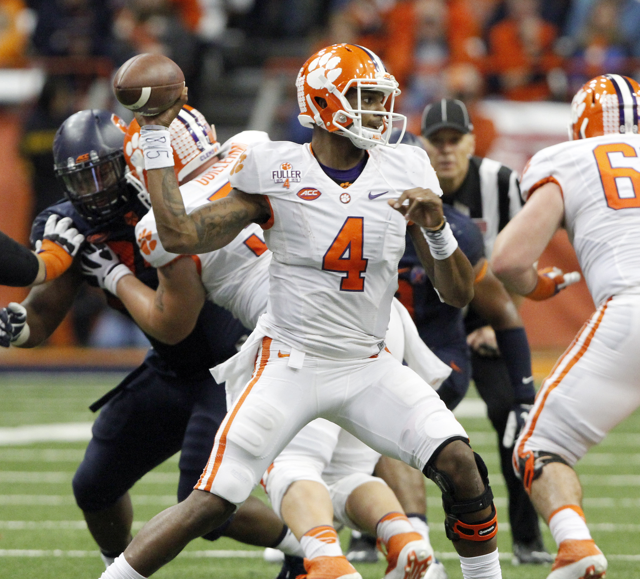 Clemson's Deshaun Watson throws a pass in the fourth quarter of an NCAA college football game against Syracuse in Syracuse, N.Y., Saturday, Nov. 14, 2015. Clemson won 37-27. (AP Photo/Nick Lisi)
