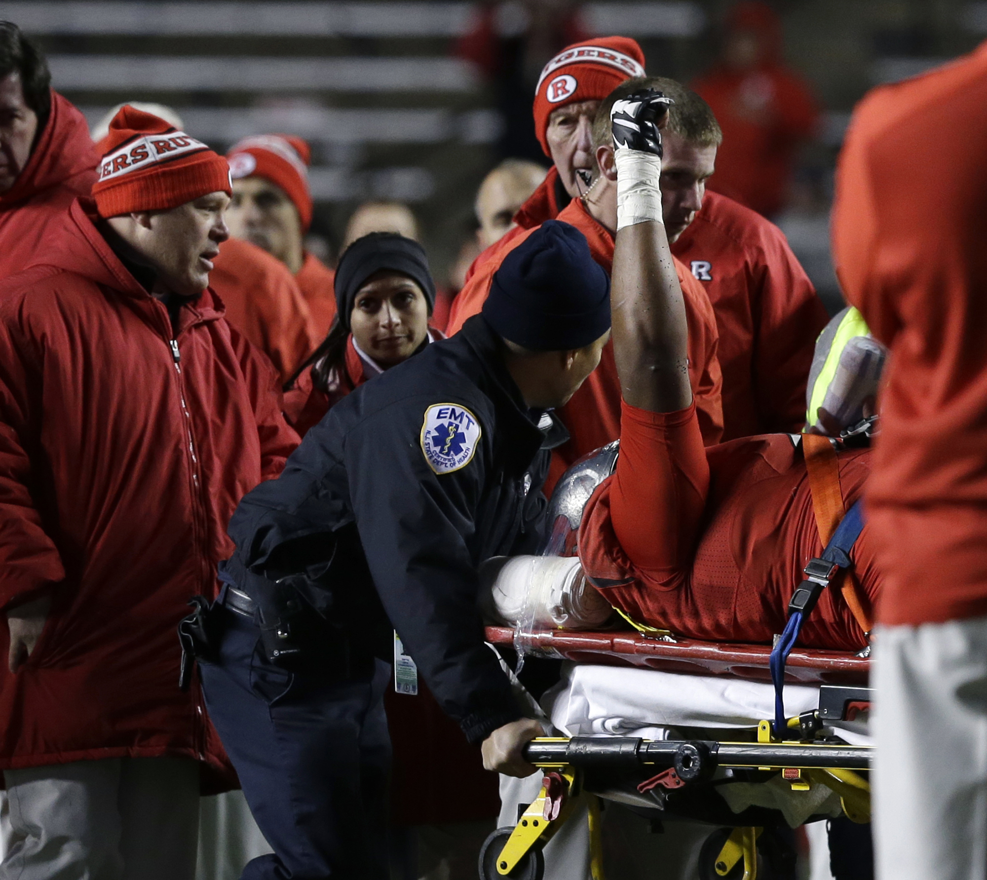 Injured Rutgers offensive lineman Derrick Nelson holds up his fist as medical personnel remove him from the field late in the second half of an NCAA college football game against Nebraska, Saturday, Nov. 14, 2015, in Piscataway, N.J. Nebraska won 31-14. (