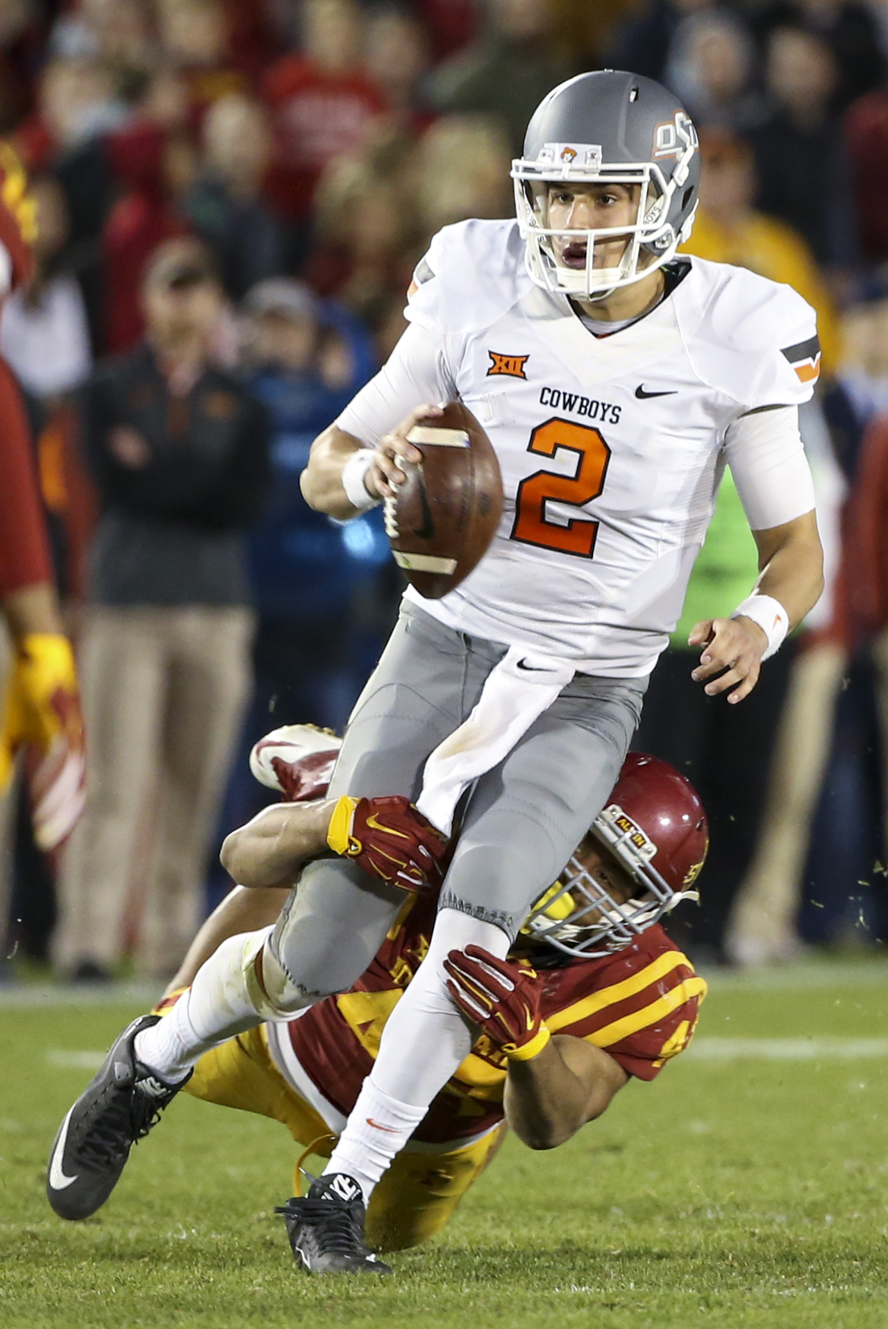 Iowa State defensive end Dale Pierson tackles Oklahoma State quarterback Mason Rudolph during the second half of an NCAA college football game, Saturday, Nov. 14, 2015, in Ames, Iowa. Oklahoma State won 35-31. (AP Photo/Justin Hayworth)