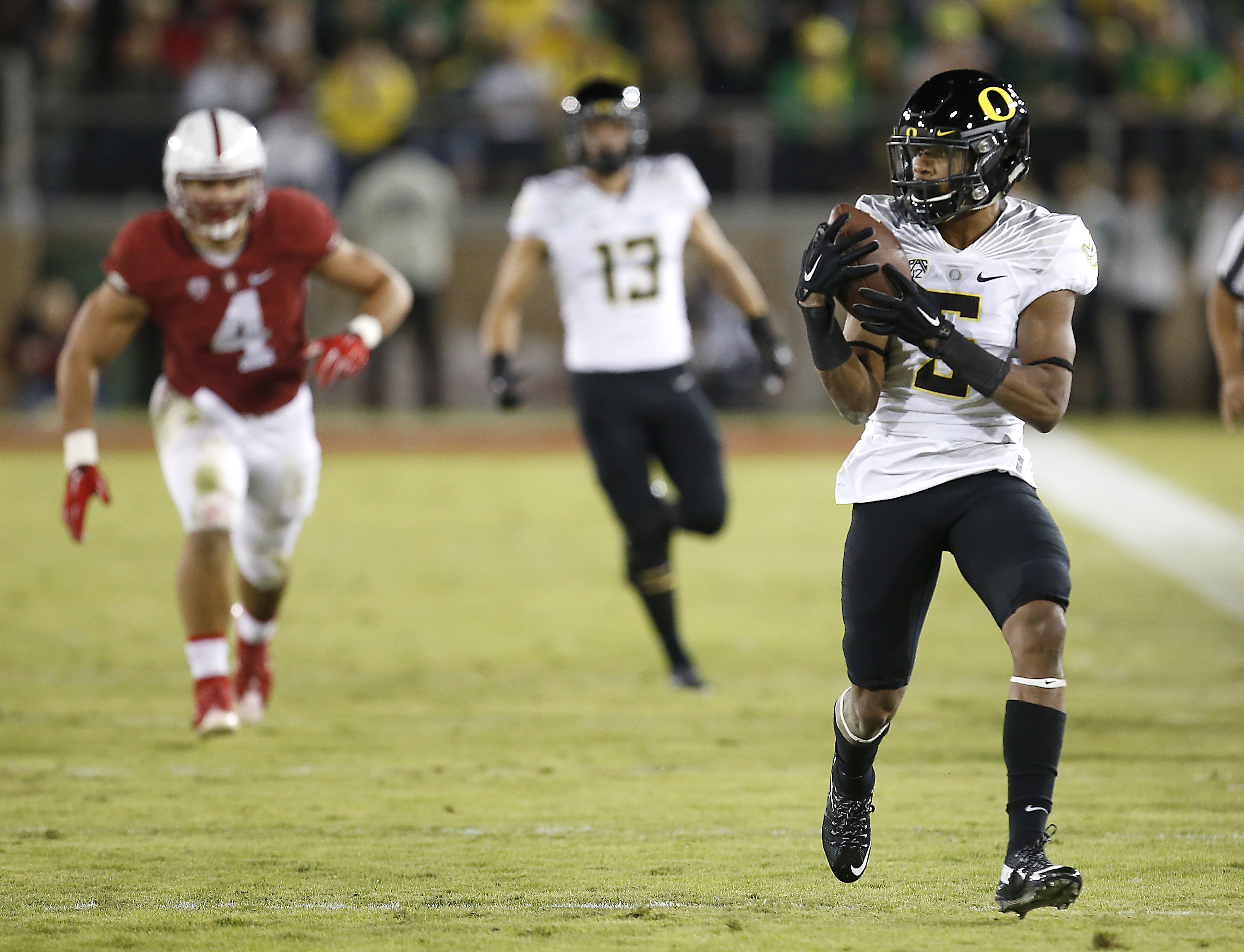 Oregon running back Taj Griffin (5) catches a pass for a touchdown against Stanford during the second half of an NCAA college football game Saturday, Nov. 14, 2015, in Stanford, Calif. (AP Photo/Tony Avelar)
