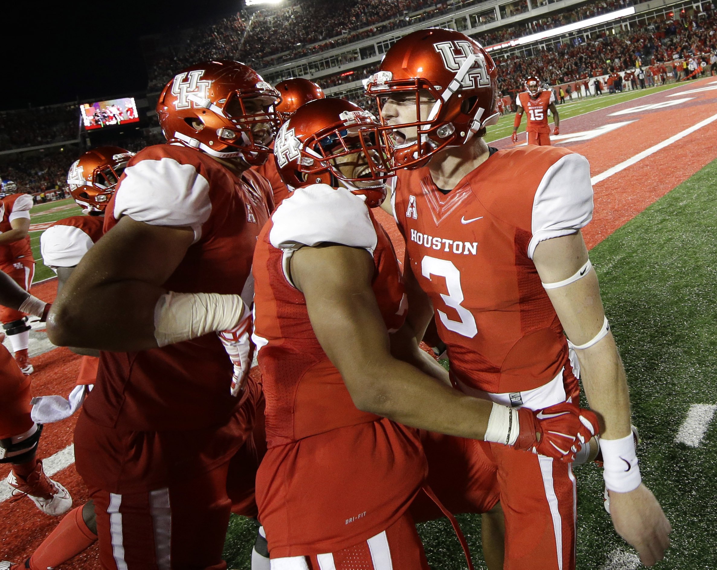 Houston quarterback Kyle Postma (3) celebrates with Chance Allen, center, and teammates after scoring a touchdown during the fourth quarter of an NCAA college football game against Memphis, Saturday, Nov. 14, 2015, in Houston. (AP Photo/David J. Phillip)
