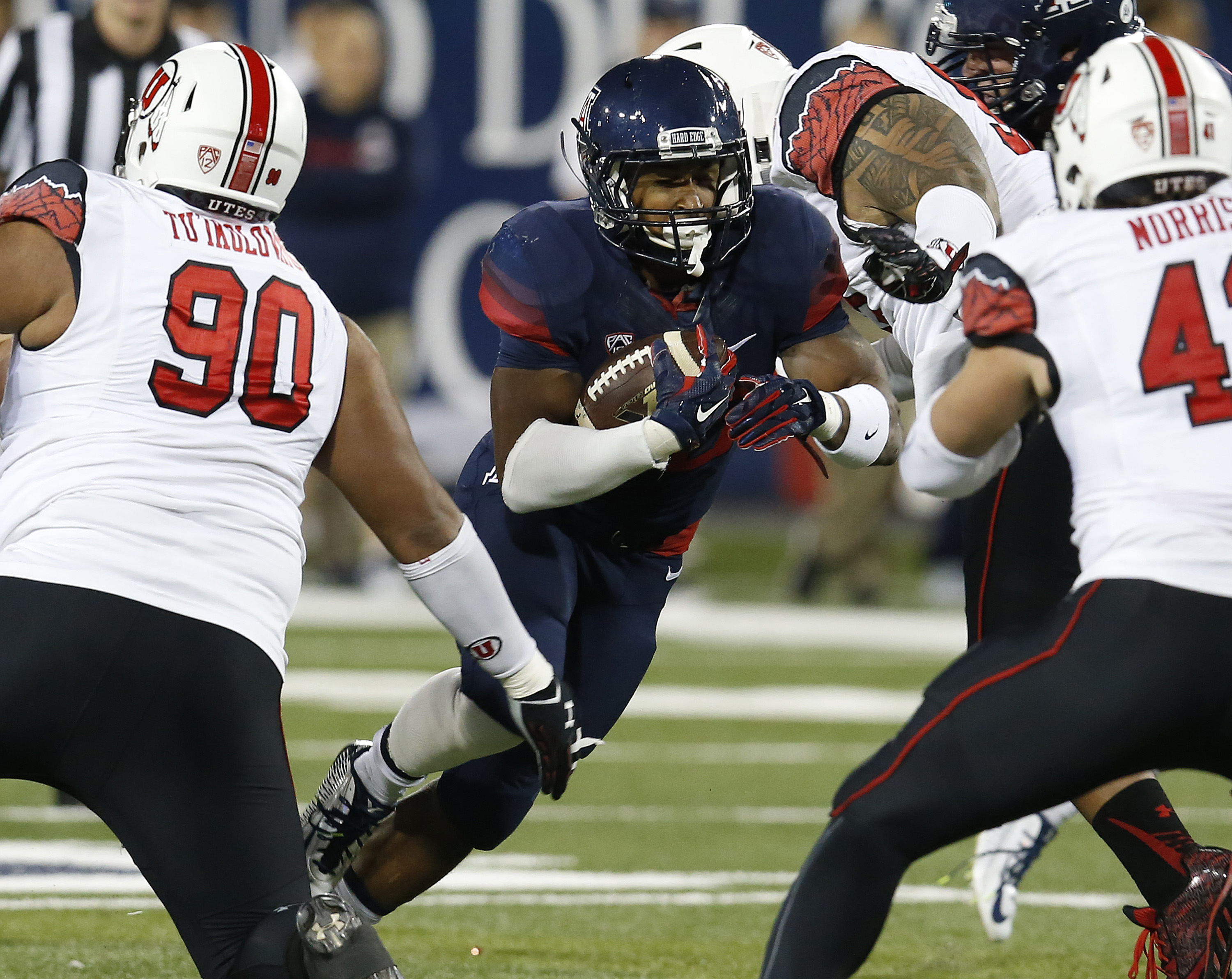 Arizona running back Jared Baker carries the ball during the first half of an NCAA college football game against Utah, Saturday, Nov. 14, 2015, in Tucson, Ariz. (AP Photo/Rick Scuteri)