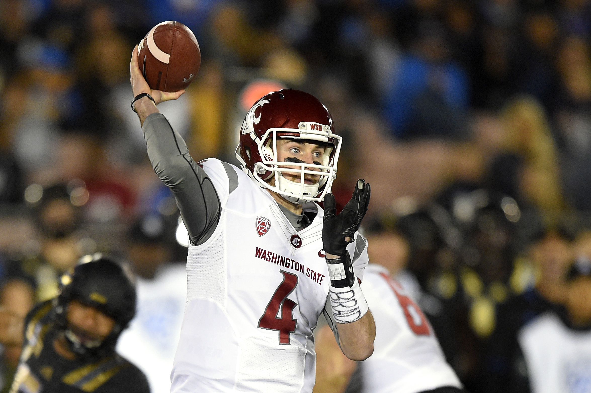 Washington State quarterback Luke Falk passes during the first half of an NCAA college football game against UCLA, Saturday, Nov. 14, 2015, in Pasadena, Calif. (AP Photo/Mark J. Terrill)