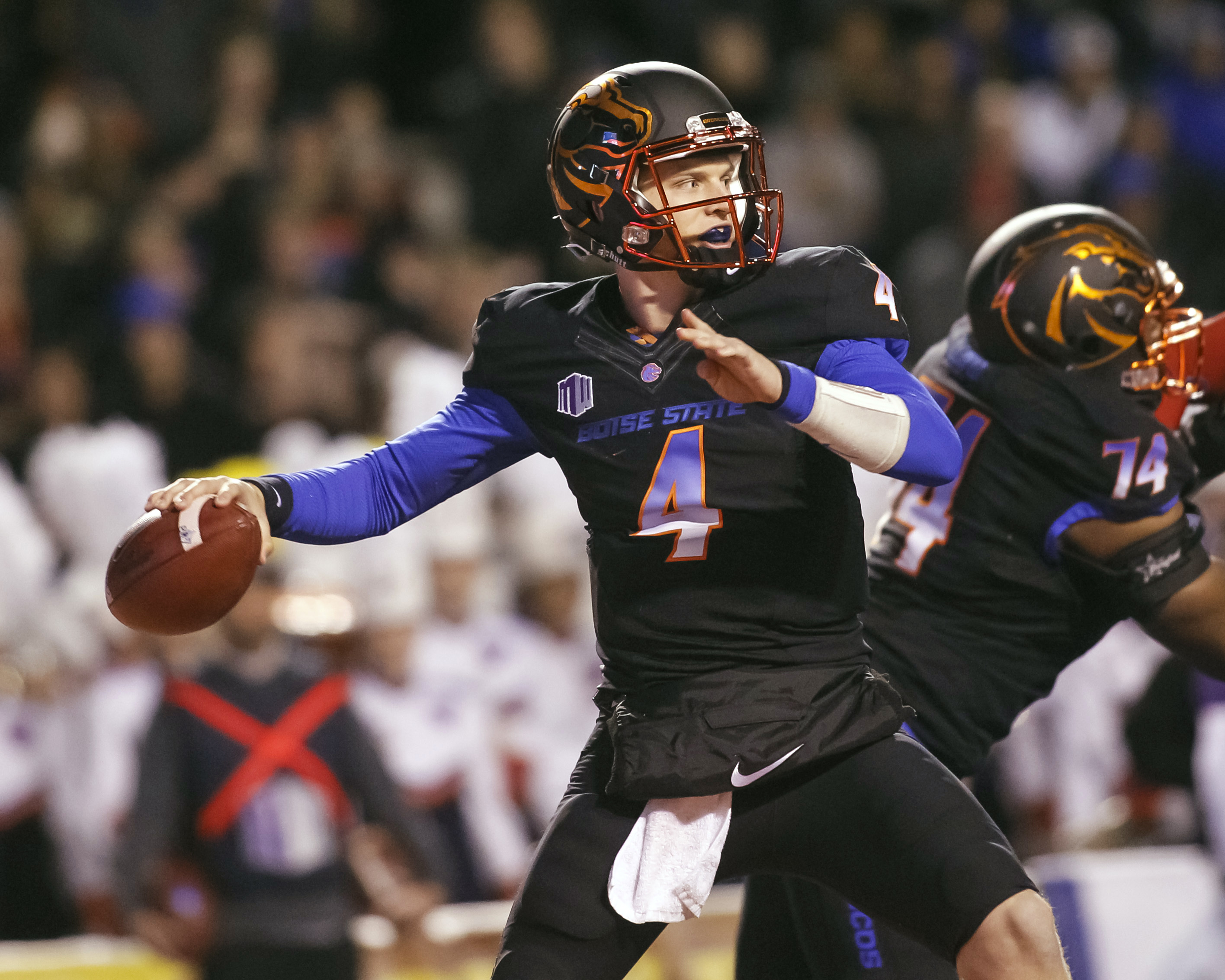 Boise State quarterback Brett Rypien (4) readies to throw a pass during the first half of an NCAA college football game against New Mexico in Boise, Idaho, on Saturday, Nov. 14, 2015. (AP Photo/Otto Kitsinger)