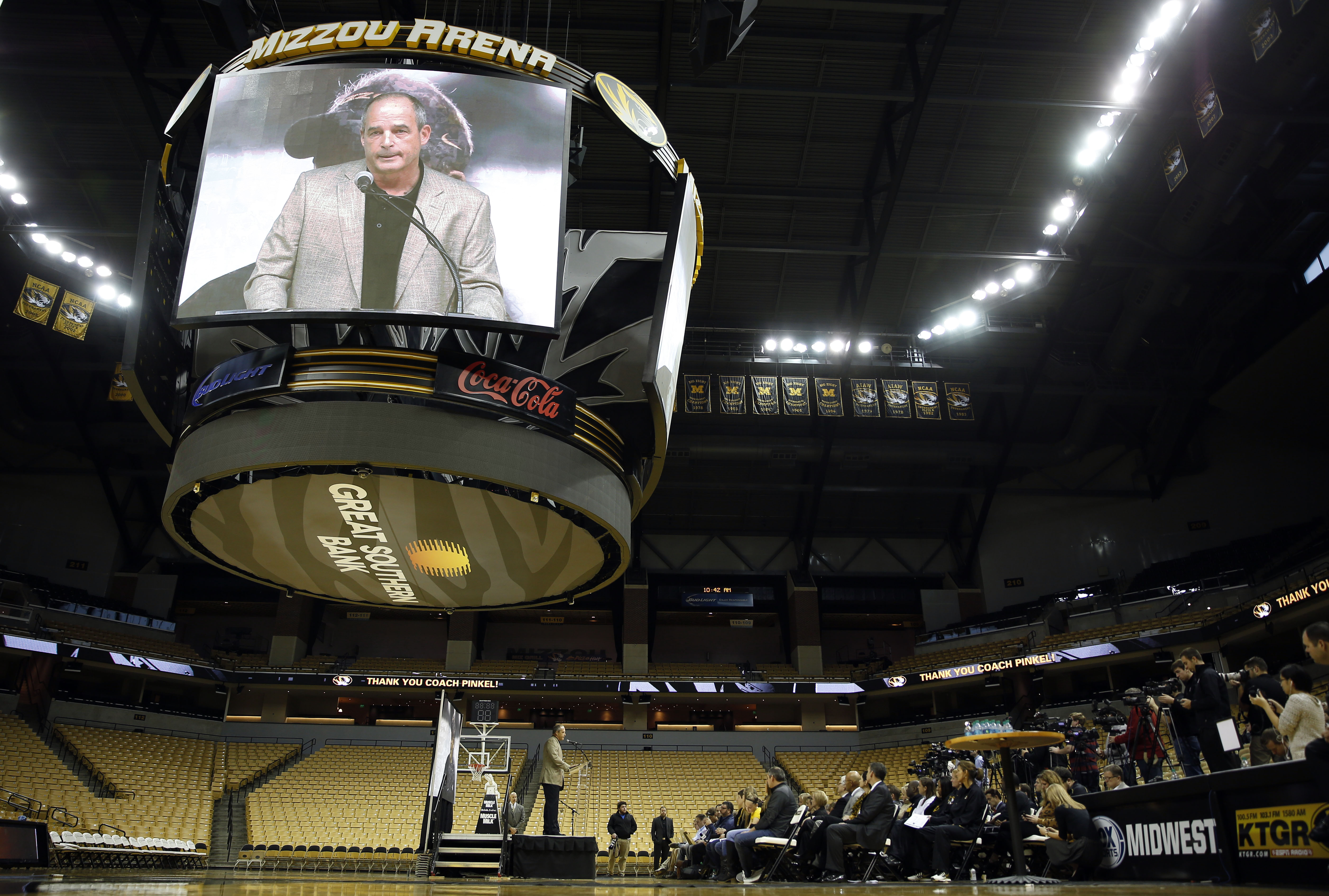 University of Missouri head football coach Gary Pinkel speaks at a podium while while also being shown on a screen above during a news conference Monday, Nov. 16, 2015, in Columbia, Mo. Pinkel has announced he will resign following the 2015 season after b