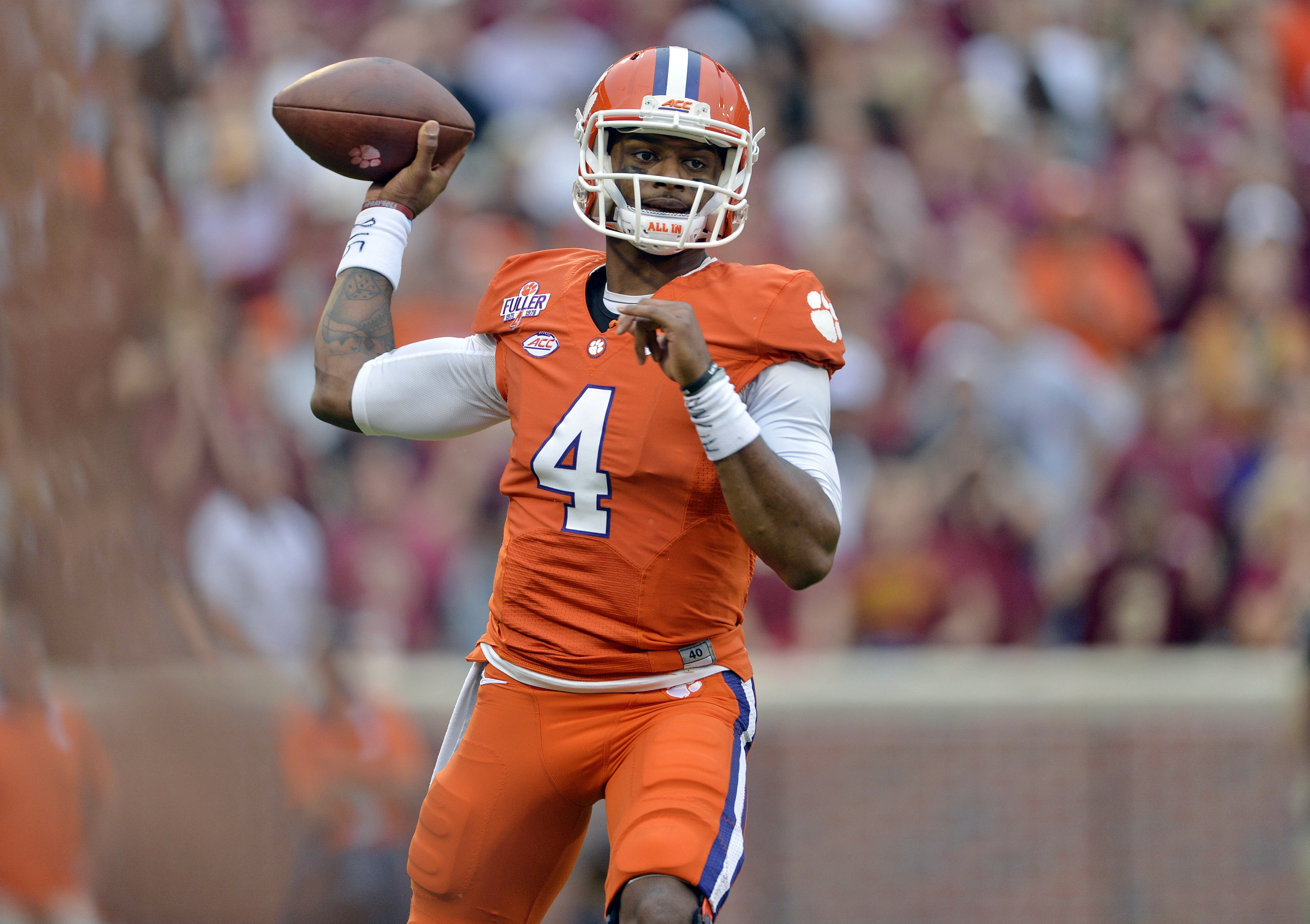 FILE - In this Nov. 7, 2015, file photo, Clemson quarterback Deshaun Watson throws a pass during the first half of an NCAA college football game against Florida State in Clemson, S.C. In the year of the running back, Watson is making a late push to keep t