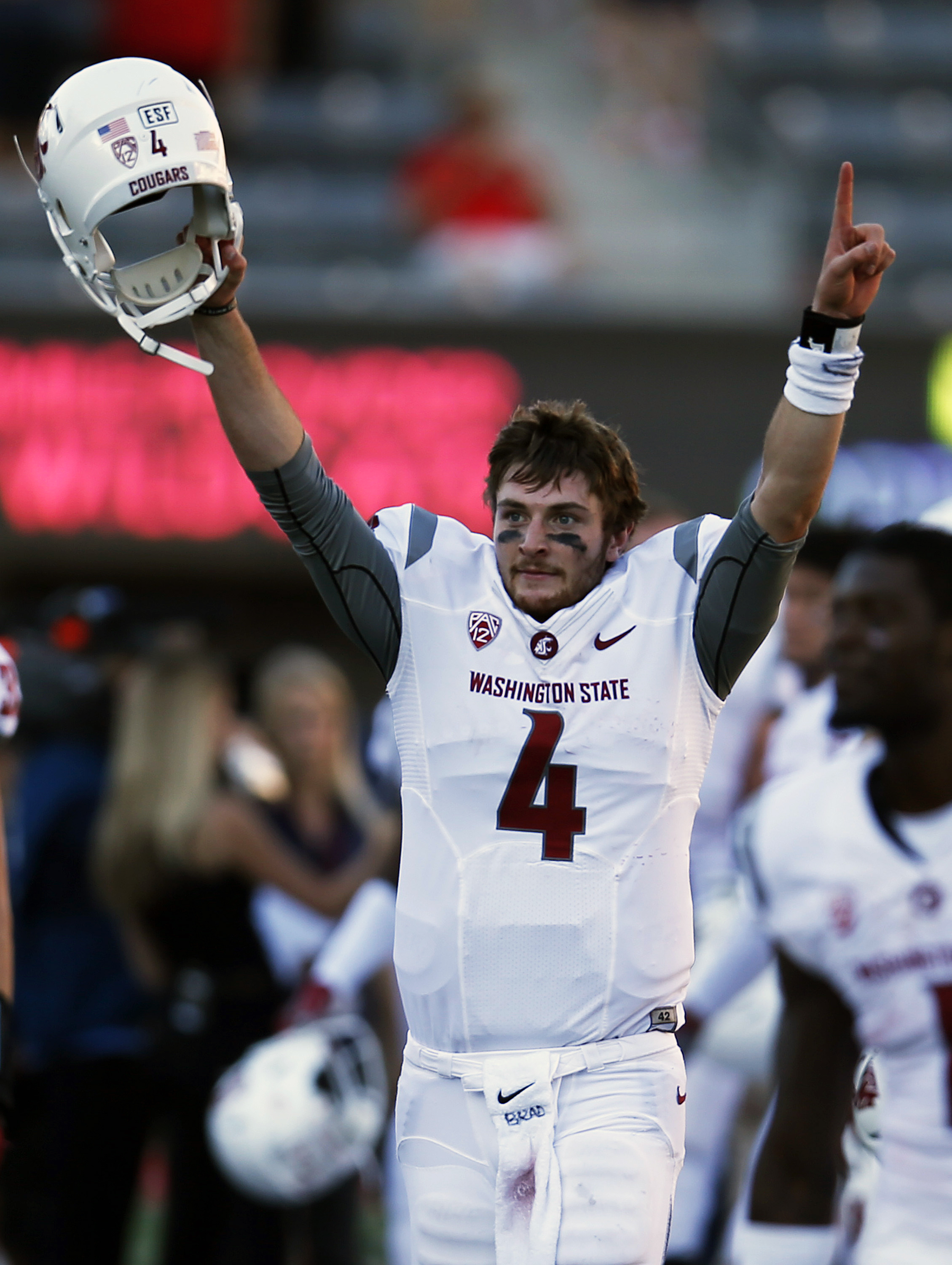 FILE - In this Oct. 24, 2015, file photo, Washington State quarterback Luke Falk celebrates after defeating Arizona 45-42 during an NCAA college football game in Tucson, Ariz. Quarterback Luke Falk has thrown for 4,067 yards and a team record 35 touchdown