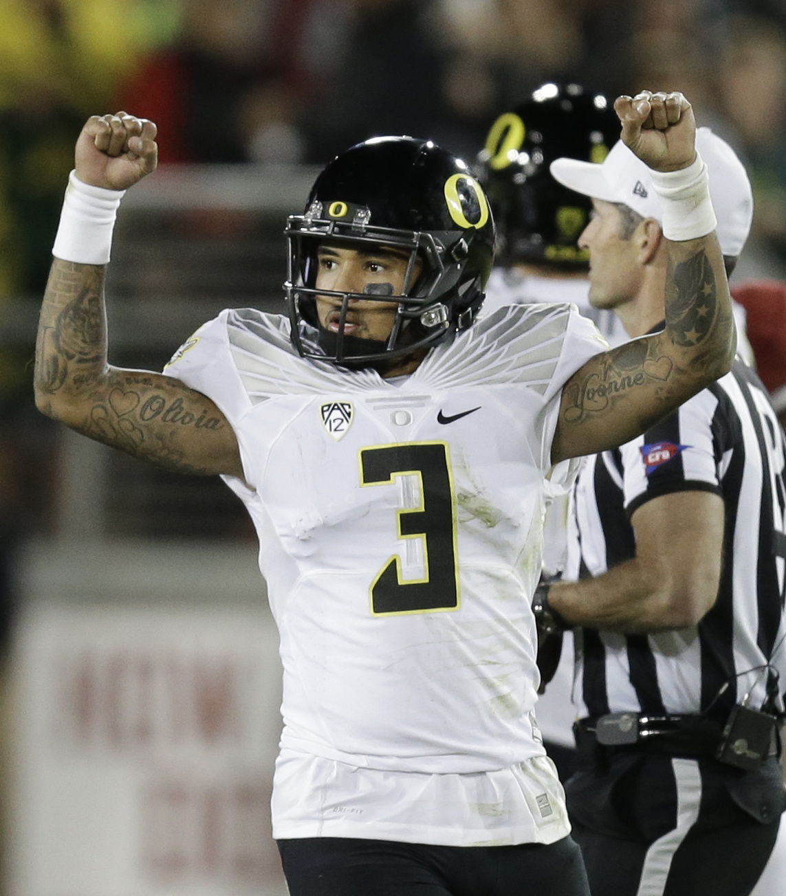 FILE - In this Nov. 14, 2015, file photo, Oregon quarterback Vernon Adams Jr. (3) celebrates at the end of an NCAA college football game against Stanford,  in Stanford, Calif. No. 22 Southern California (7-3) is at No. 23 Oregon (7-3) Saturday and both te