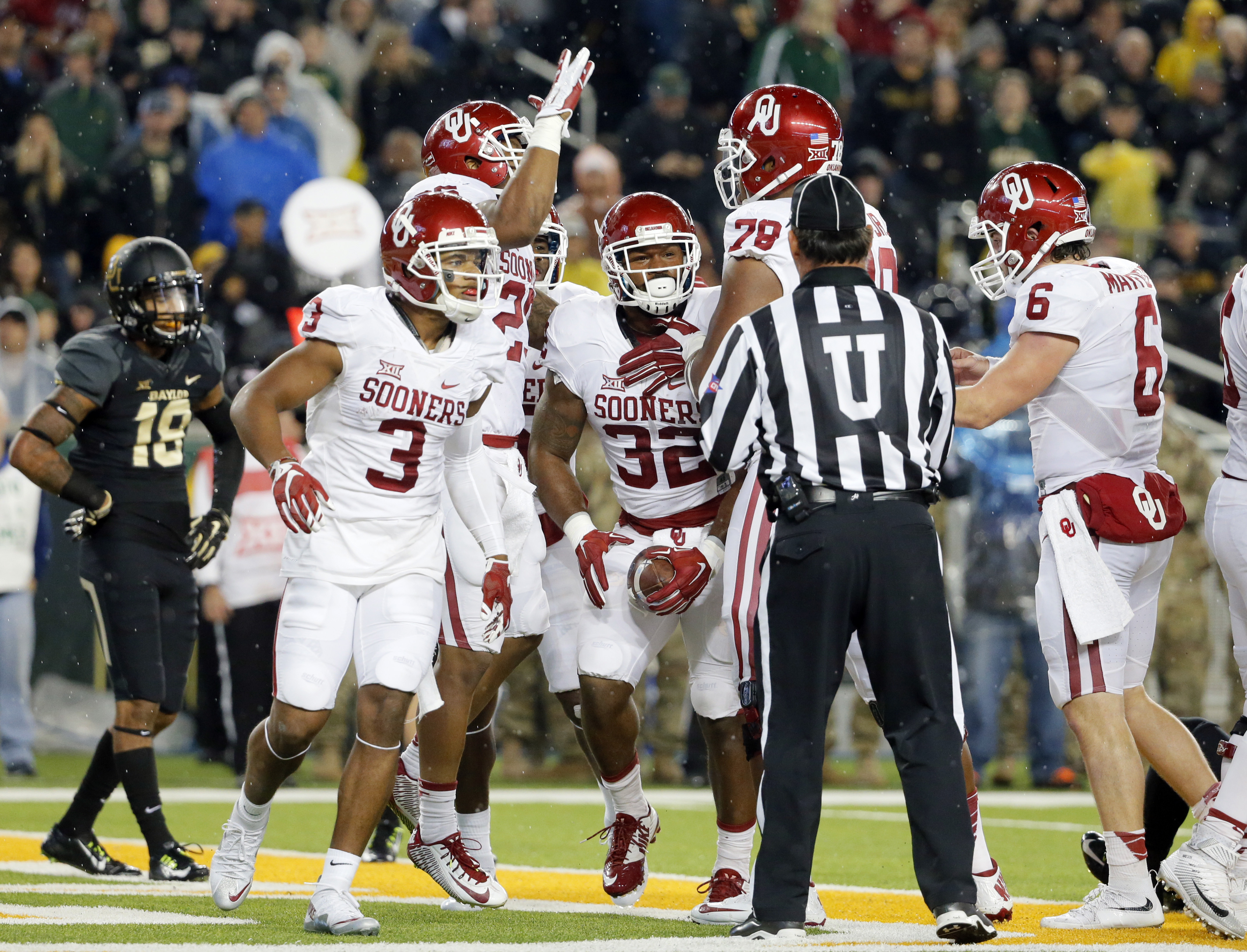 FILE - In this Saturday, Nov. 14, 2015, file photo, Oklahoma's Sterling Shepard (3), Orlando Brown (78) and Baker Mayfield (6) celebrate a touchdown scored by Samaje Perine (32) on a running play against Baylor in the first half of an NCAA college footbal