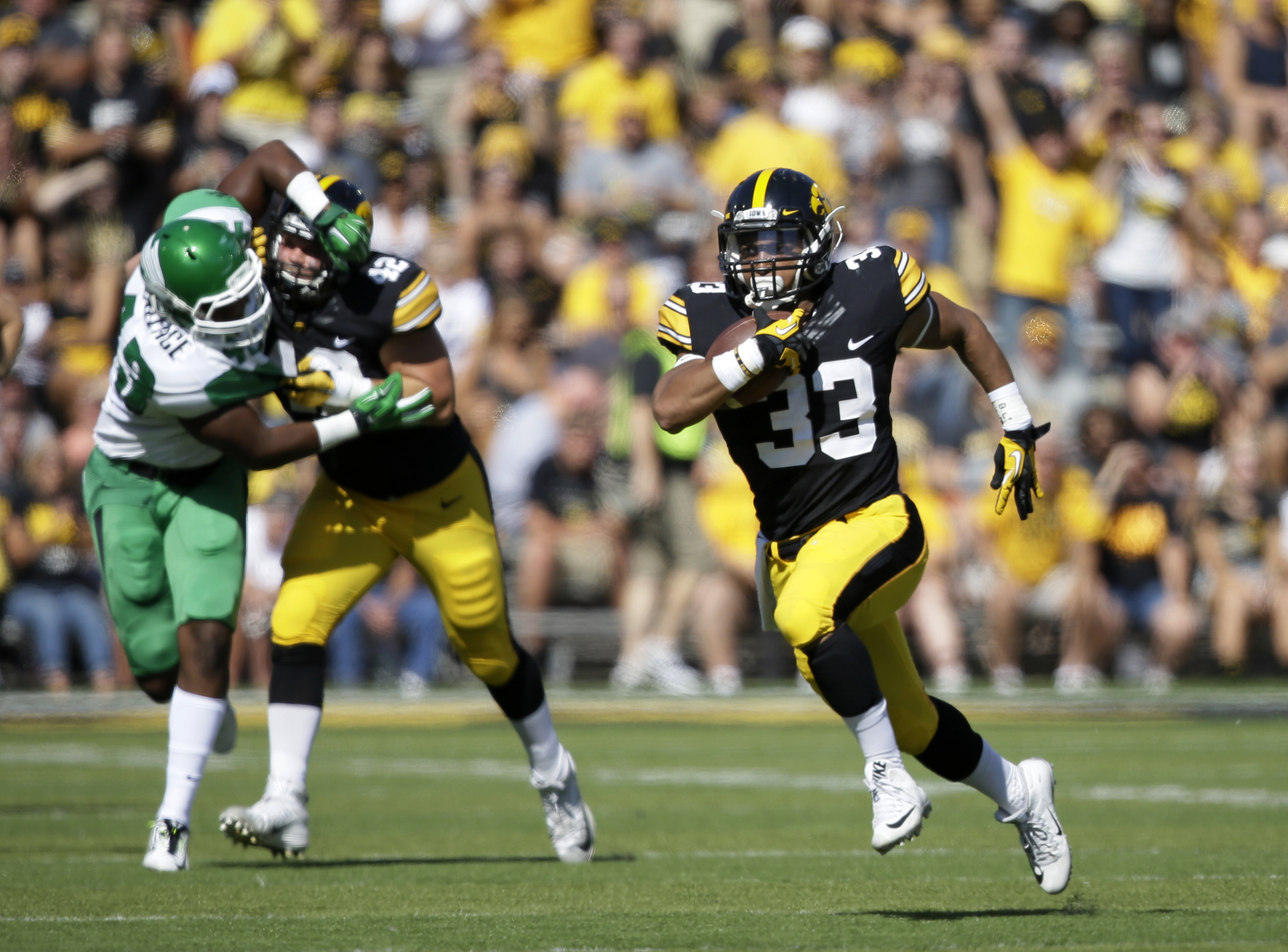 FILE - In this Sept. 26, 2015, file photo, Iowa running back Jordan Canzeri (33) carries the ball during an NCAA college football game against North Texas in Iowa City, Iowa. Iowa expects to have all four of the running backs in their rotation--Canzeri, L
