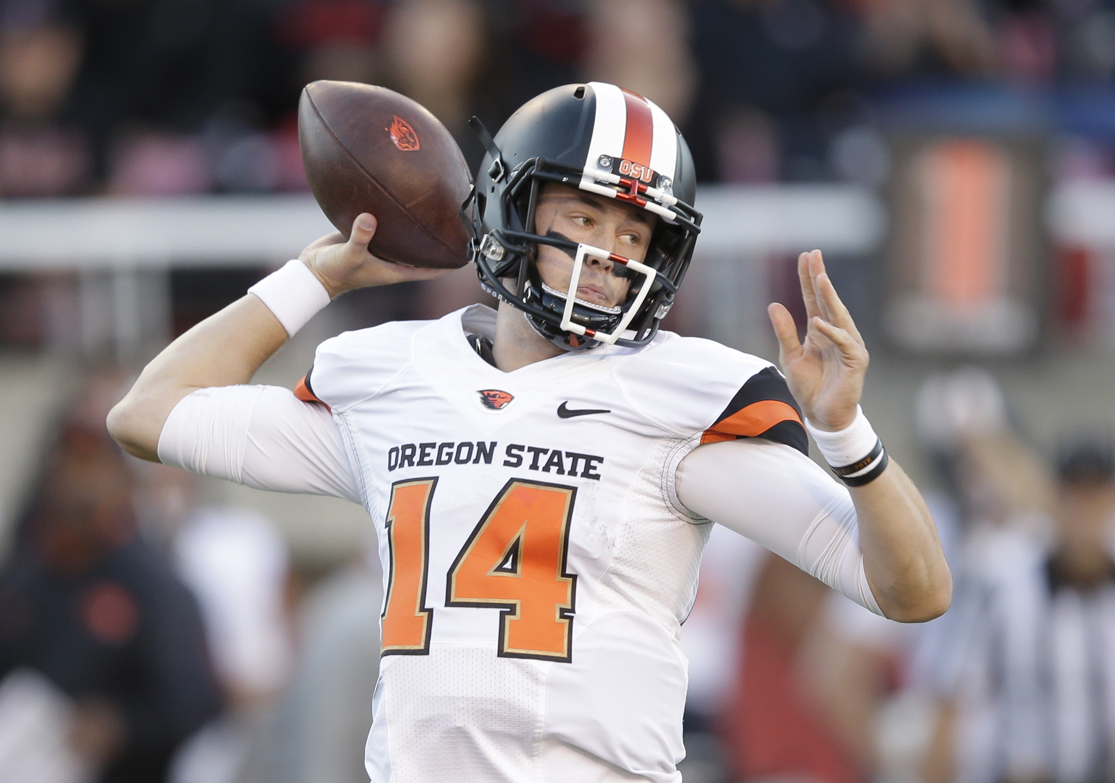 FILE - In this Oct. 31, 2015, file photo, Oregon State quarterback Nick Mitchell (14) passes the ball against Utah in the first quarter during an NCAA college football game, in Salt Lake City. Washington plays at Oregon State on Saturday. (AP Photo/Rick B