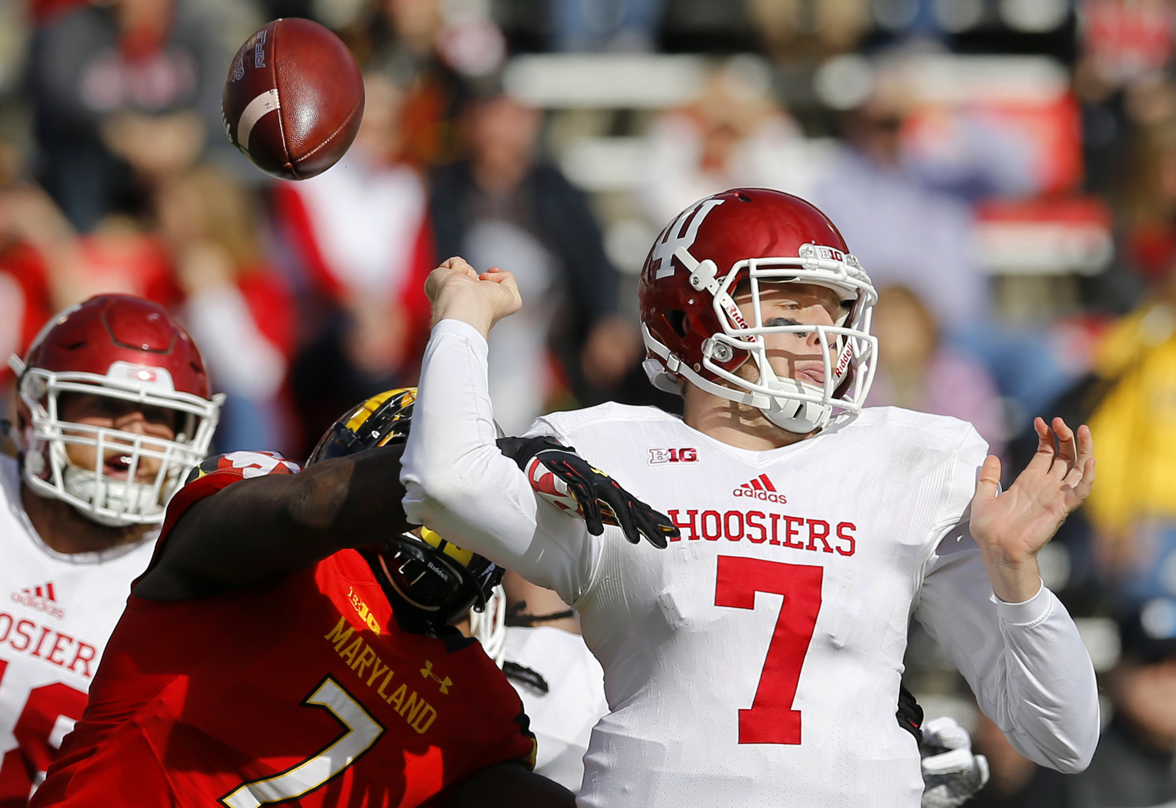 Maryland defensive lineman Yannick Ngakoue, left, strips the ball from Indiana quarterback Nate Sudfeld in the first half of an NCAA college football game, Saturday, Nov. 21, 2015, in College Park, Md. Maryland recovered the ball on the play. (AP Photo/Pa