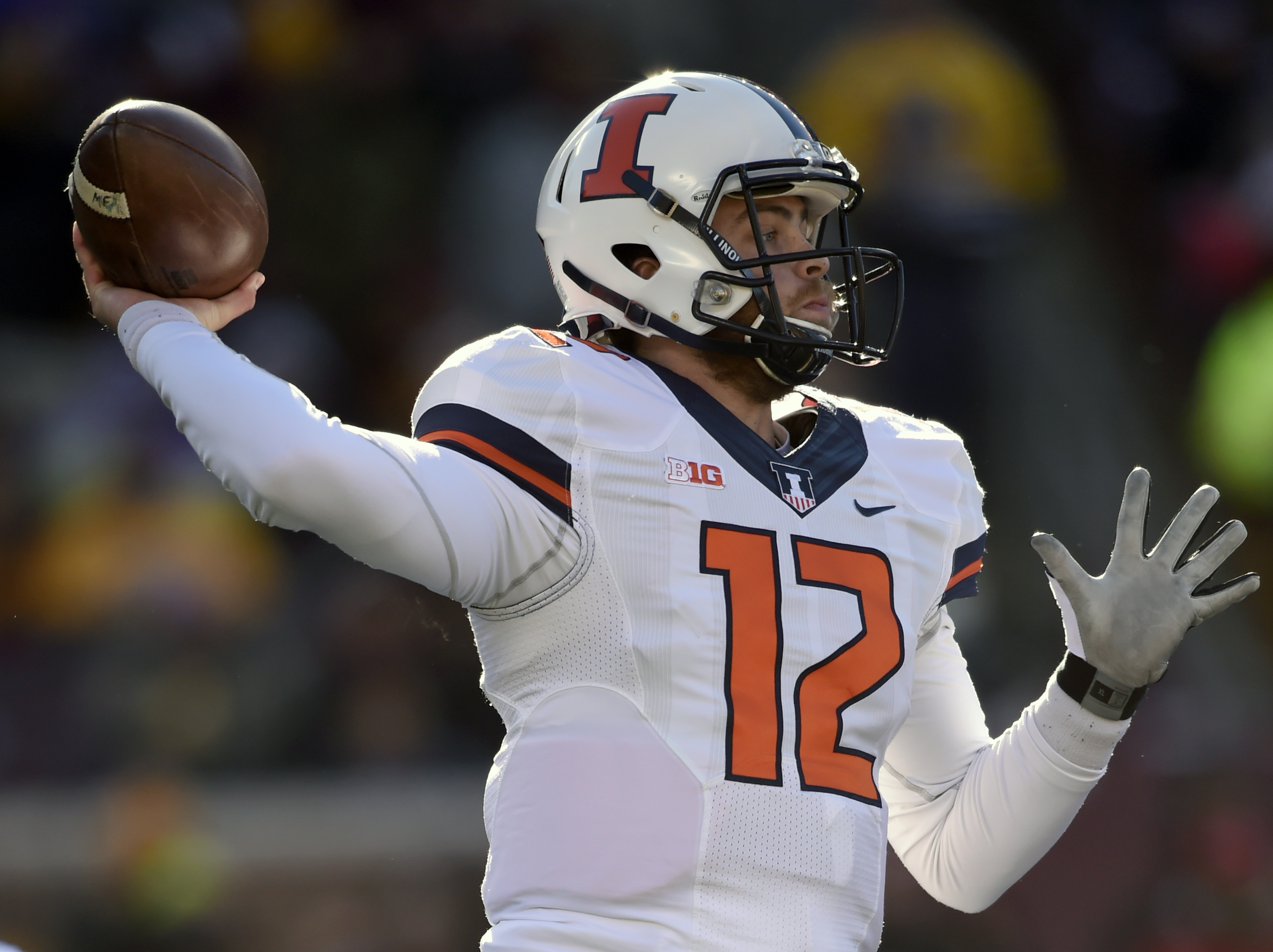 Illinois' quarterback Wes Lunt (12) passes against the Minnesota in the second quarter of an NCAA college football game on Saturday, Nov. 21, 2015, in Minneapolis. (AP Photo/Hannah Foslien)