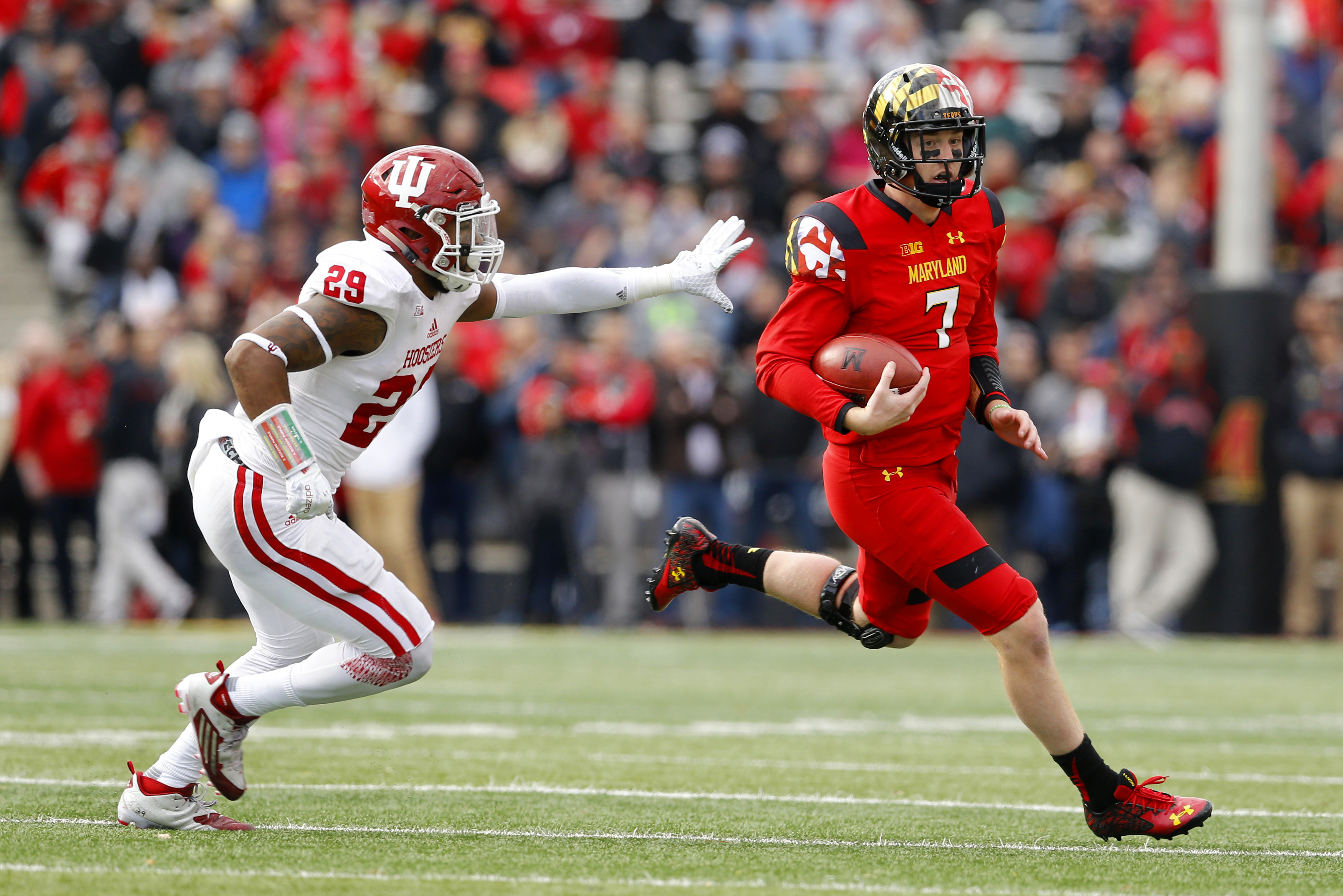 Maryland quarterback Caleb Rowe, right, rushes the ball past Indiana linebacker Dawson Fletcher in the first half of an NCAA college football game, Saturday, Nov. 21, 2015, in College Park, Md. (AP Photo/Patrick Semansky)