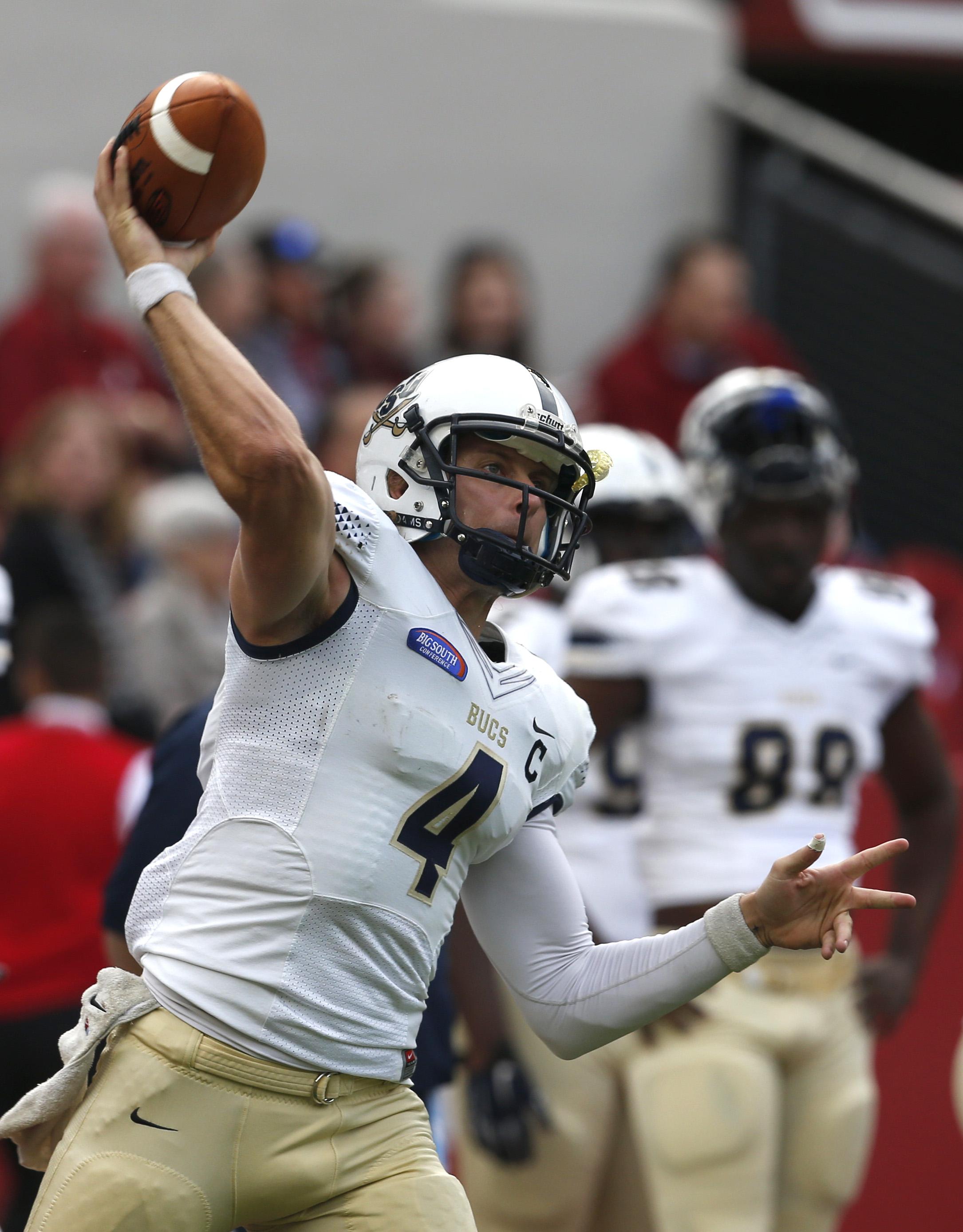 Charleston Southern quarterback Austin Brown (4) warms up before an NCAA football game against Alabama, Saturday, Nov. 21, 2015, in Tuscaloosa, Ala. (AP Photo/Butch Dill)