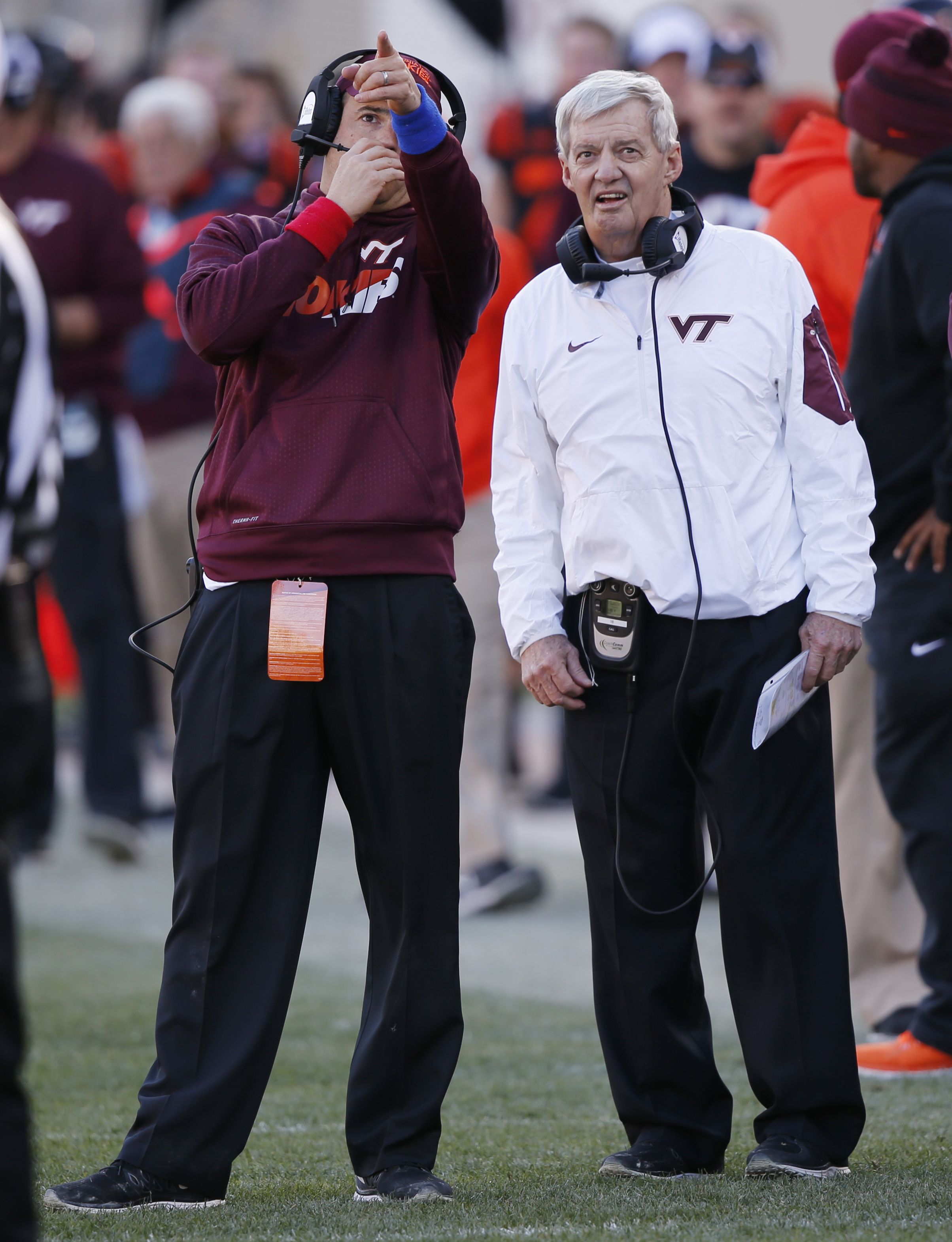 Virginia Tech assistant coach Shane Beamer, watches a replay on the scoreboard with his father, head coach Frank Beamer during the second half of an NCAA college football game in Blacksburg, Va., Saturday, Nov. 21, 2015.  North Carolina won the game 30-27
