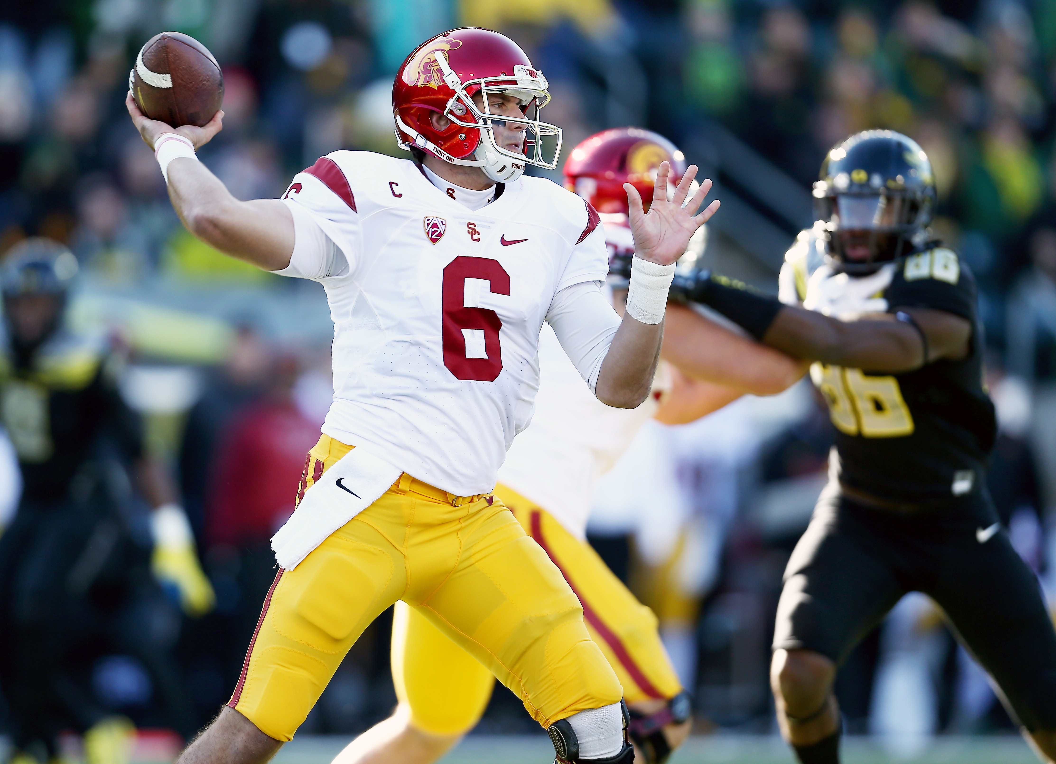 Southern California quarterback Cody Kessler (6) throws the football during the first half of an NCAA college football game against Oregon, Saturday, Nov. 21, 2015, in Eugene, Ore. (AP Photo/Ryan Kang)
