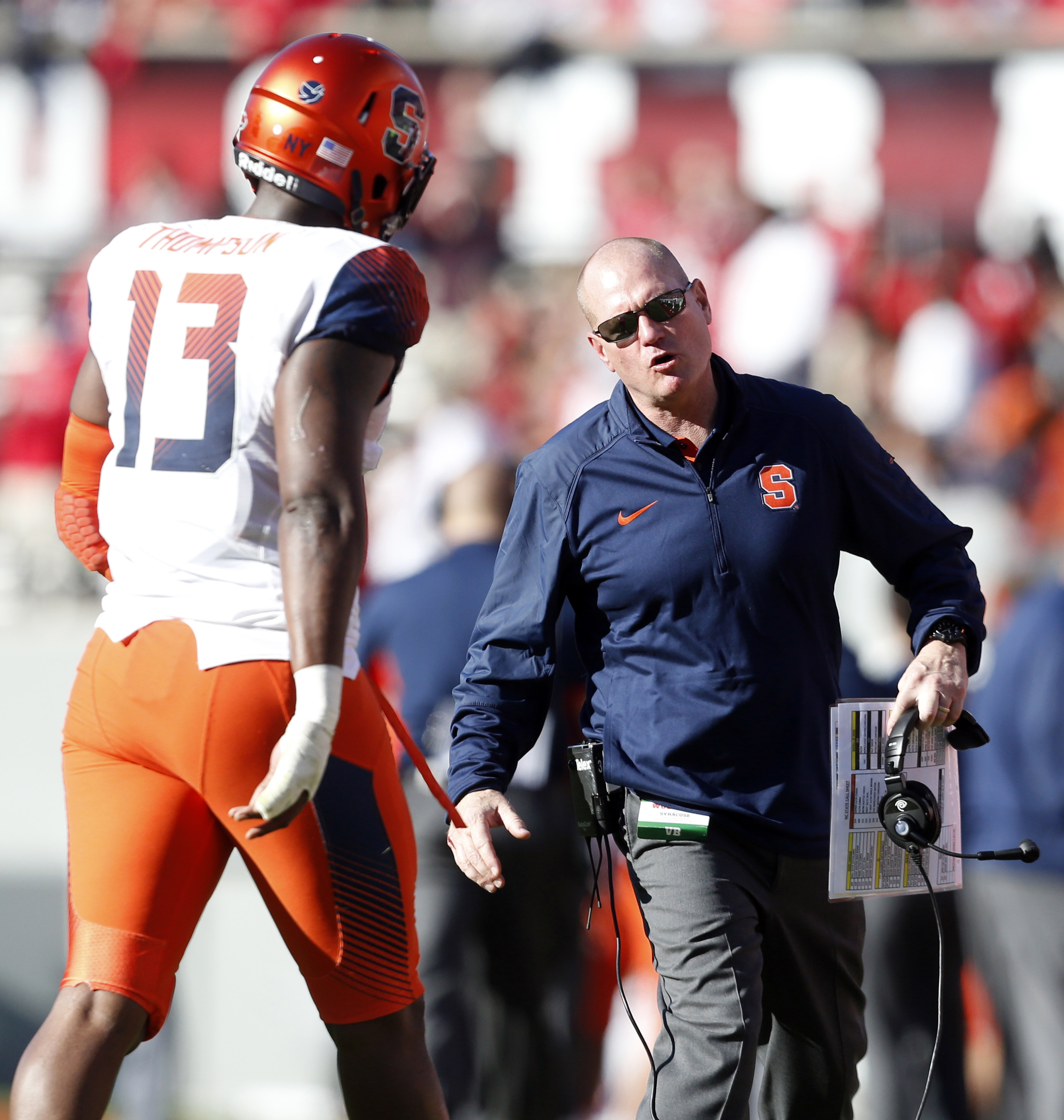 Syracuse head coach Scott Shafer, right, talks to Ron Thompson (13) during the second half of an NCAA college football game against North Carolina State in Raleigh, N.C., Saturday, Nov. 21, 2015. (Ethan Hyman/The News & Observer via AP) MANDATORY CREDIT
