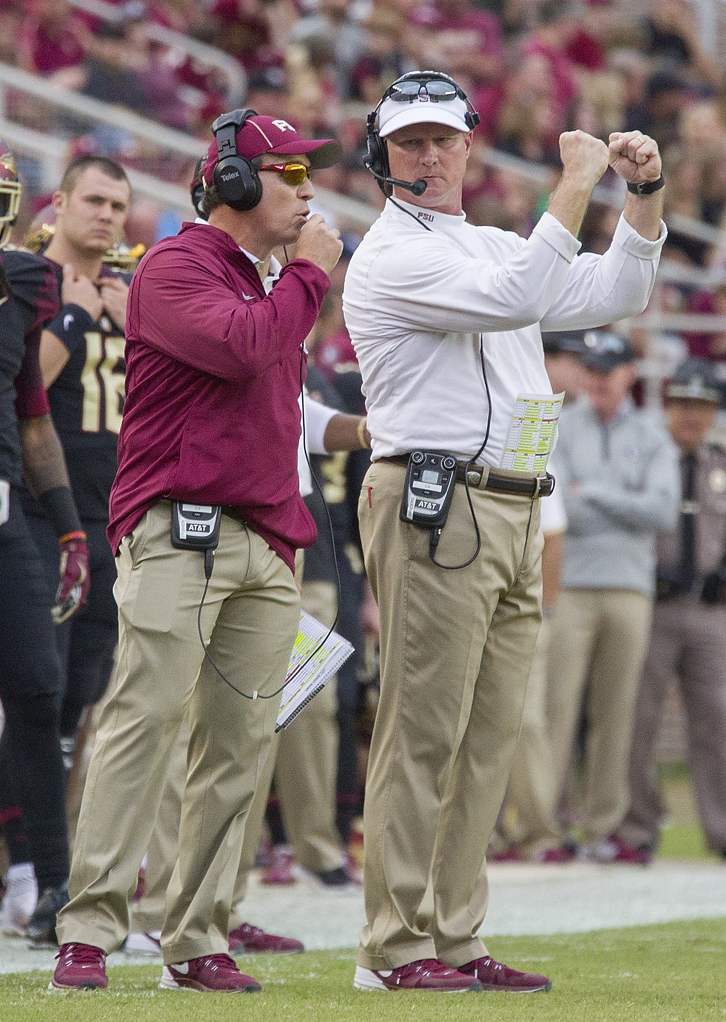 Florida State head coach Jimbo Fisher, left, send in a play via his offensive coordinator Randy Sanders in the first half of an NCAA college football game against Chattanooga in Tallahassee, Fla., Saturday, Nov. 21, 2015.  (AP Photo/Mark Wallheiser)