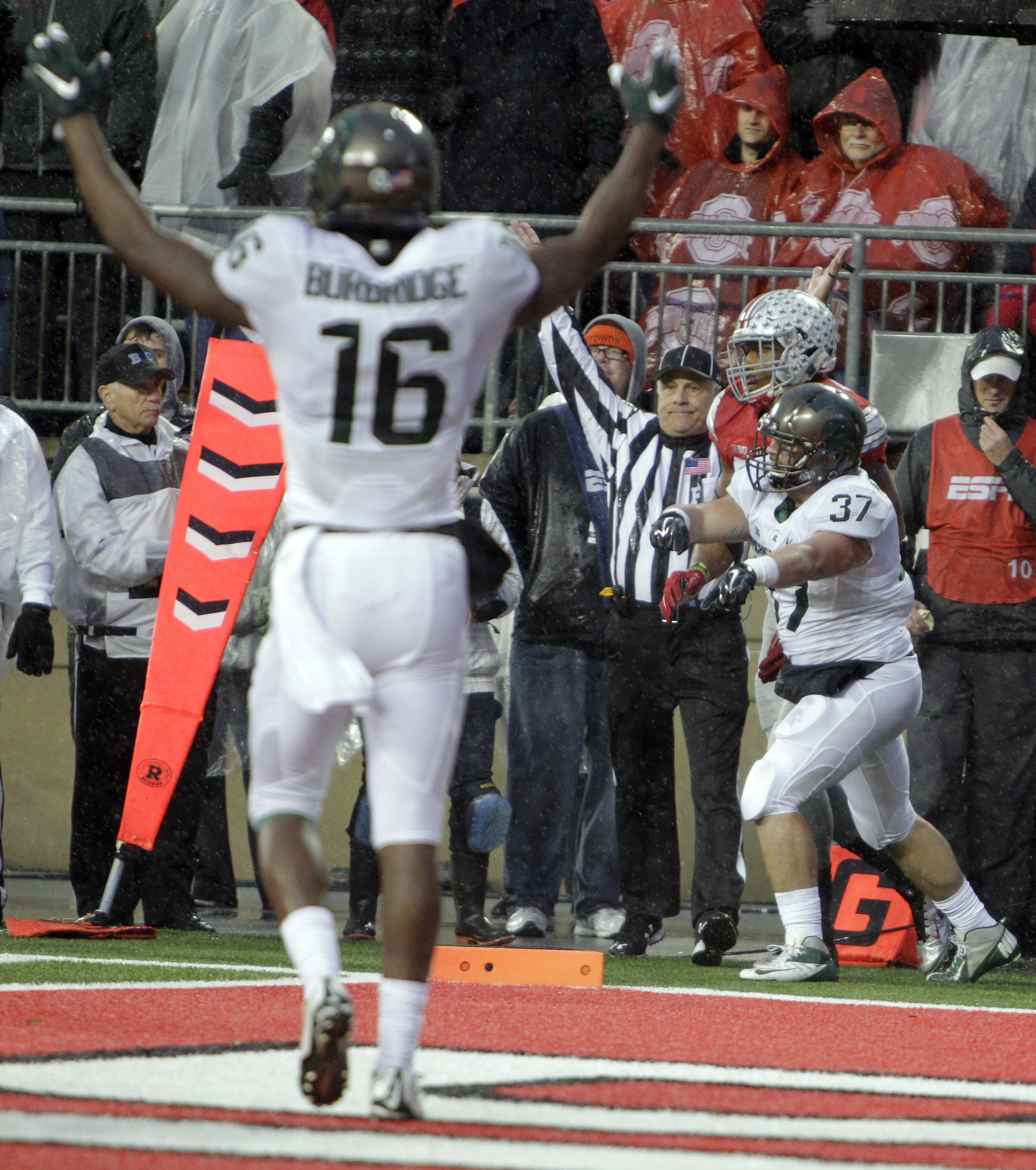 Michigan State fullback Trevon Pendelton, right, celebrates his touchdown against Ohio State during the second quarter of an NCAA college football game, Saturday, Nov. 21, 2015, in Columbus, Ohio. (AP Photo/Jay LaPrete)