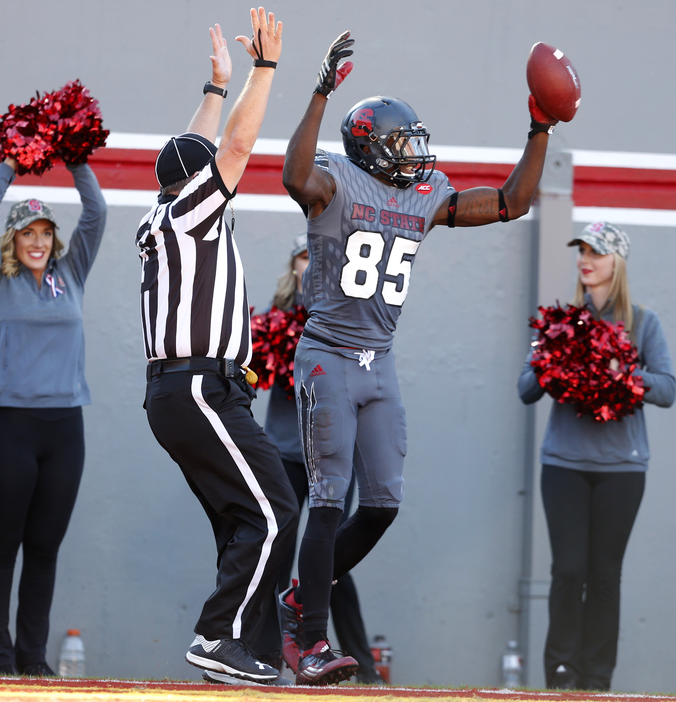 North Carolina State wide receiver Jumichael Ramos (85) celebrates a 5-yard touchdown reception during the second half of an NCAA college football game against Syracuse in Raleigh, N.C., Saturday, Nov. 21, 2015. (Ethan Hyman/The News & Observer via AP) MA