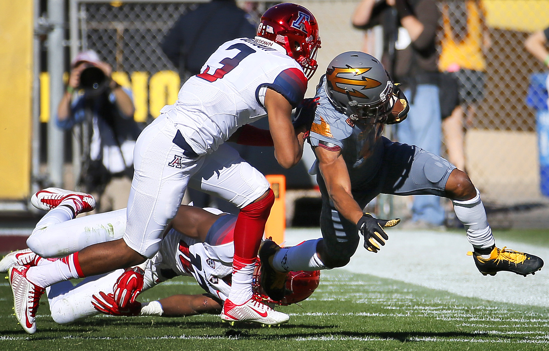 Arizona State running back Demario Richard, right, is knocked out of bounds by Arizona cornerback Cam Denson (3) during the first half of an NCAA college football game Saturday, Nov. 21, 2015, in Tempe, Ariz. (AP Photo/Matt York)