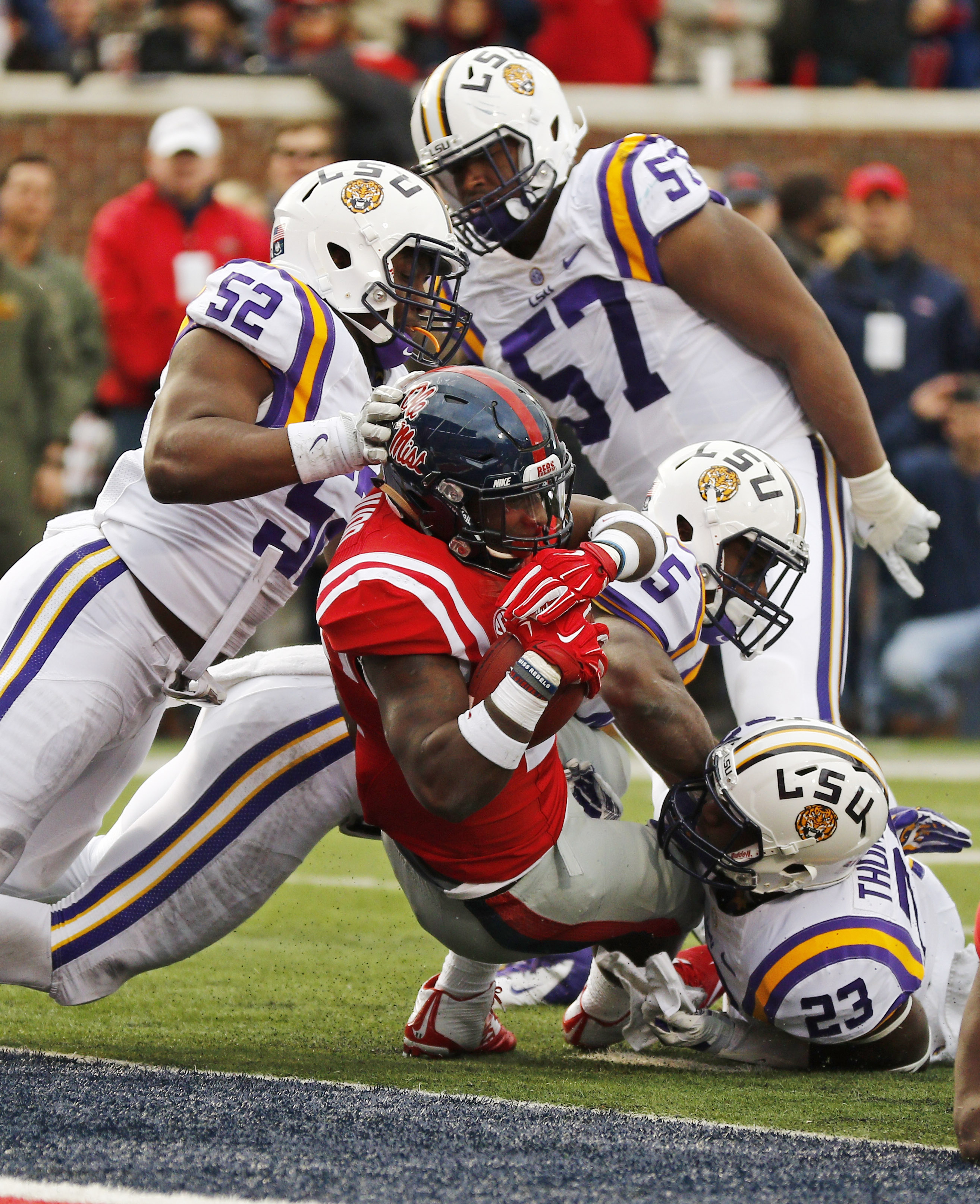 Mississippi running back Jaylen Walton (6) stretches past LSU linebacker Kendell Beckwith (52) for a 2-yard touchdown run in the first half of an NCAA college football game in Oxford, Miss., Saturday, Nov. 21, 2015. (AP Photo/Rogelio V. Solis)