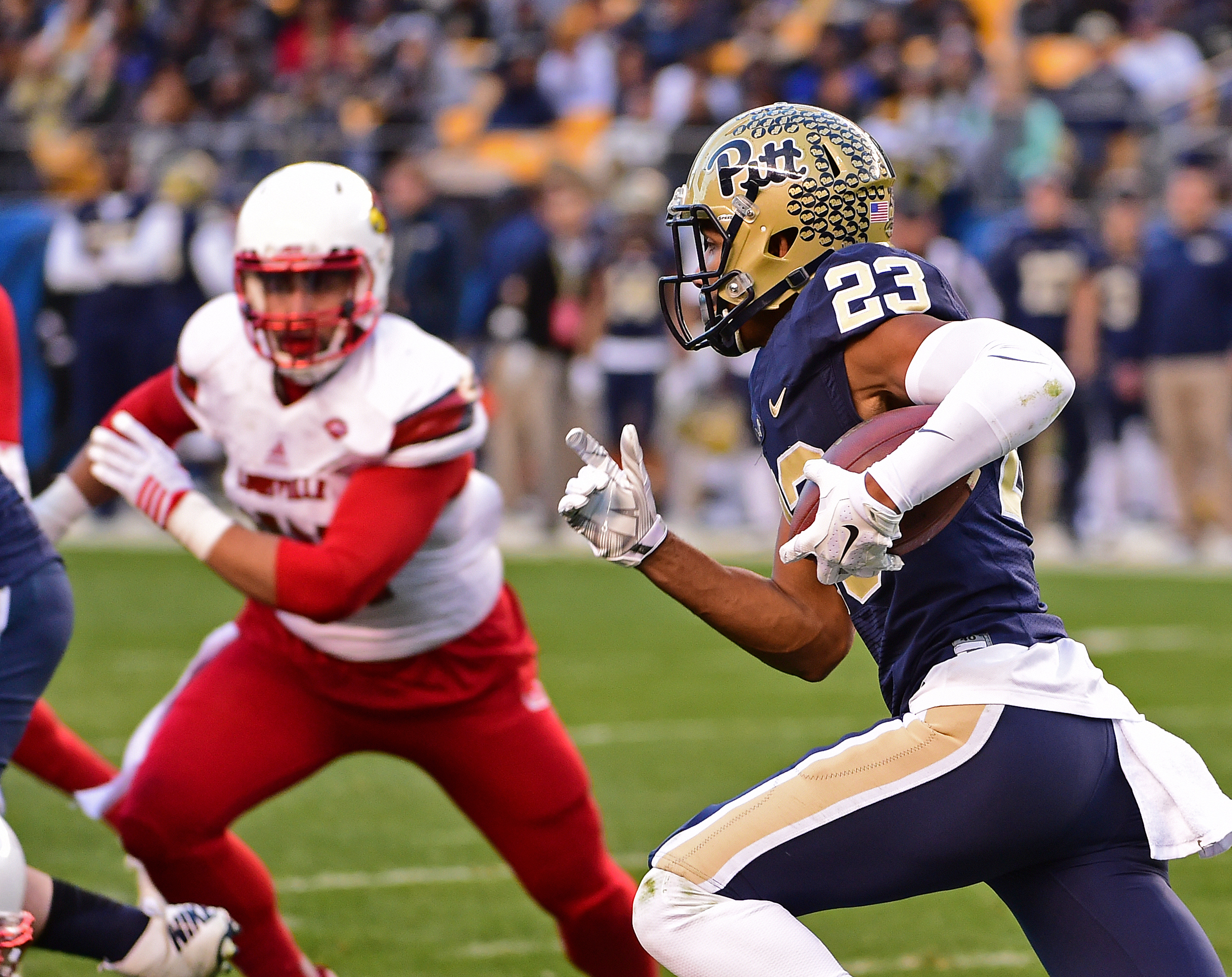 Pittsburgh wide receiver Tyler Boyd (23) runs the ball during the first half of an NCAA collge football game against Louisville, Saturday, Nov. 21, 2015 in Pittsburgh. (AP Photo/Fred Vuich)