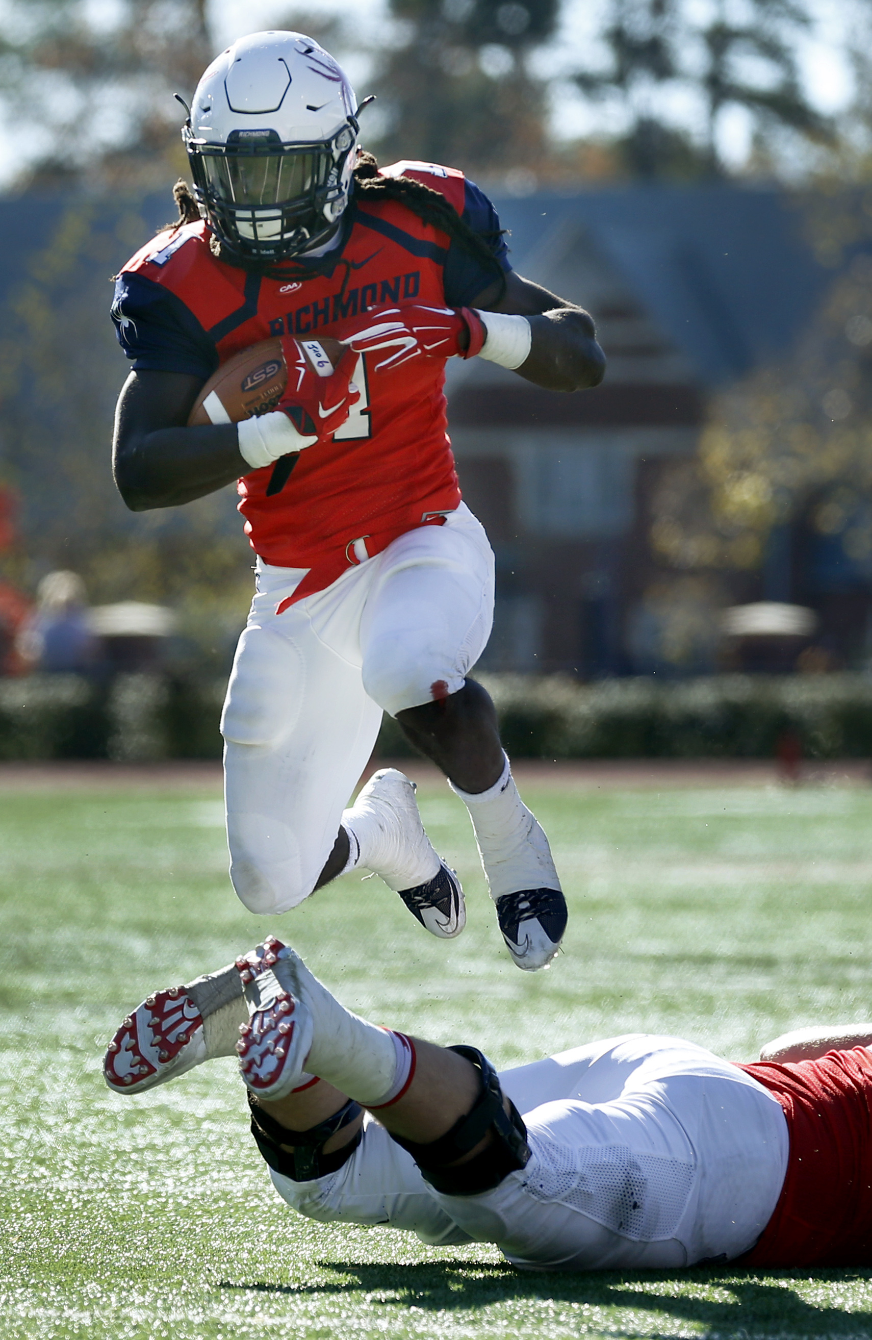 Richmond's Jacobi Green leaps over his offensive lineman during the second quarter of an NCAA college football game agaisnt William & Mary,  Saturday, Nov. 21, 2015 in Richmond, Va. (Dean Hoffmeyer/Richmond Times-Dispatch via AP) MANDATORY CREDIT