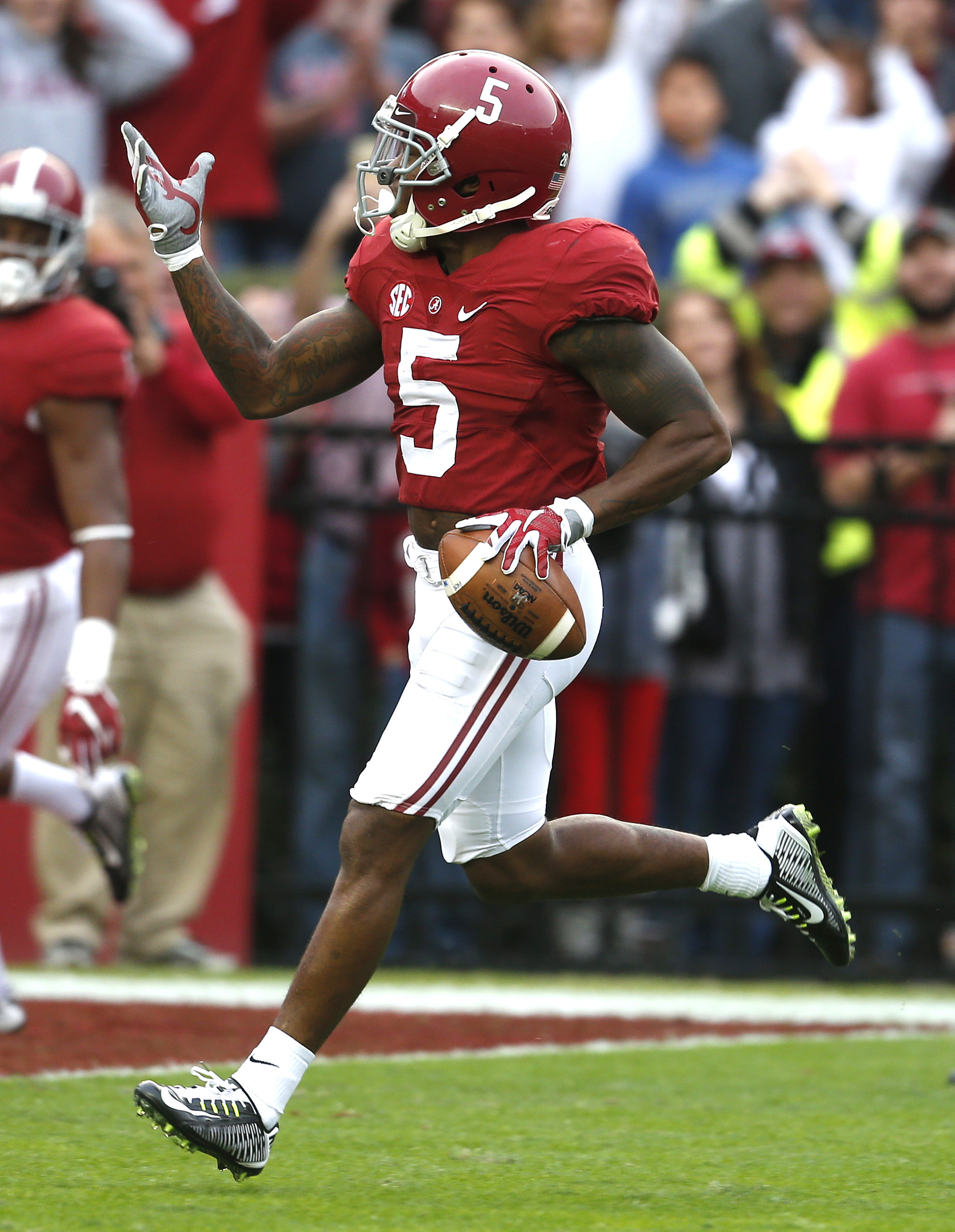 Alabama defensive back Cyrus Jones (5) returns a punt for a touchdown during the first half of an NCAA football game against Charleston Southern, Saturday, Nov. 21, 2015, in Tuscaloosa, Ala. (AP Photo/Butch Dill)