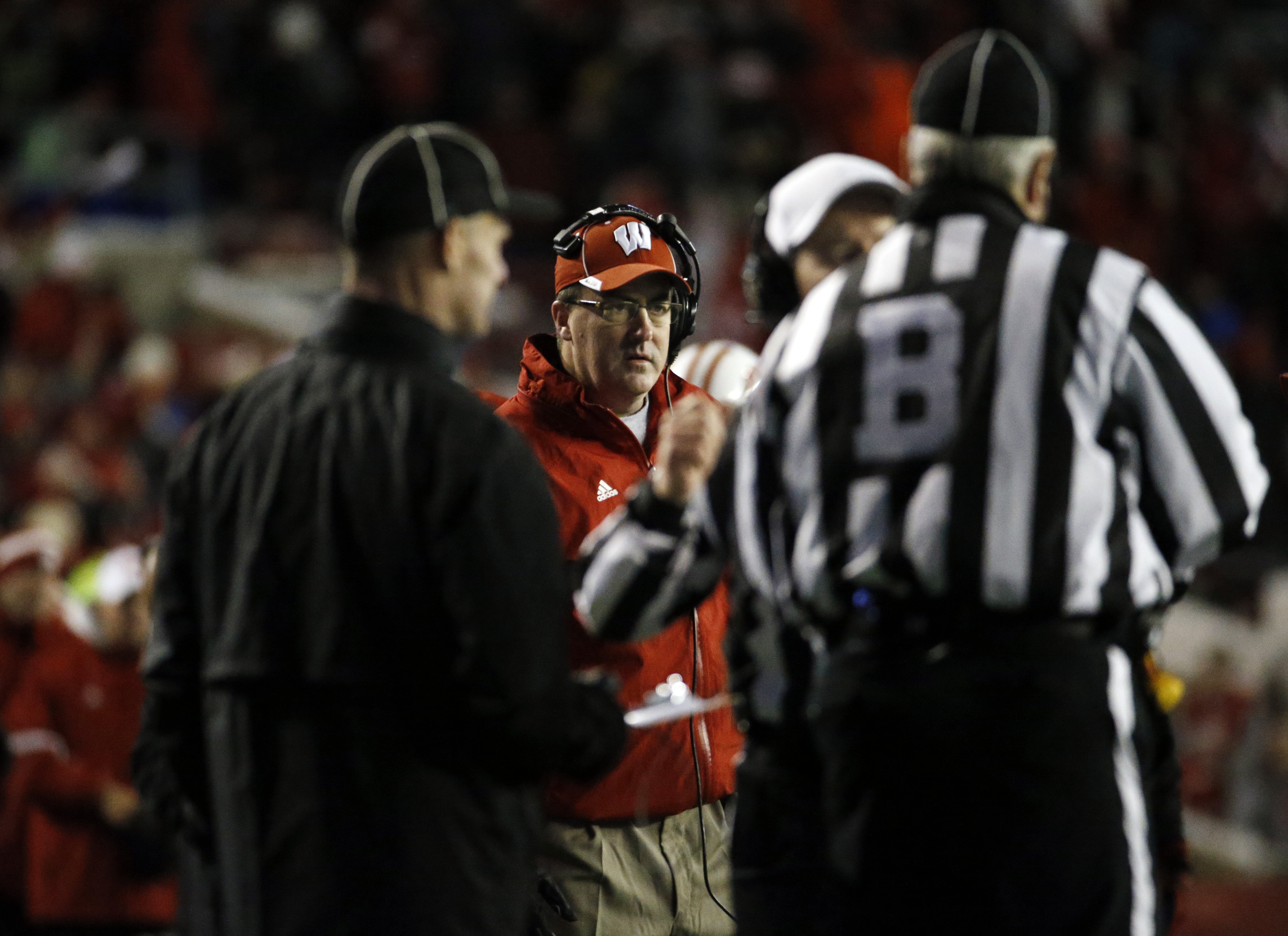 Wisconsin head coach Paul Chryst watches as a play is reviewed by referees during the final seconds of an NCAA college football game against Northwestern Saturday, Nov. 21, 2015, in Madison, Wis. Northwestern won 13-7. (AP Photo/Morry Gash)