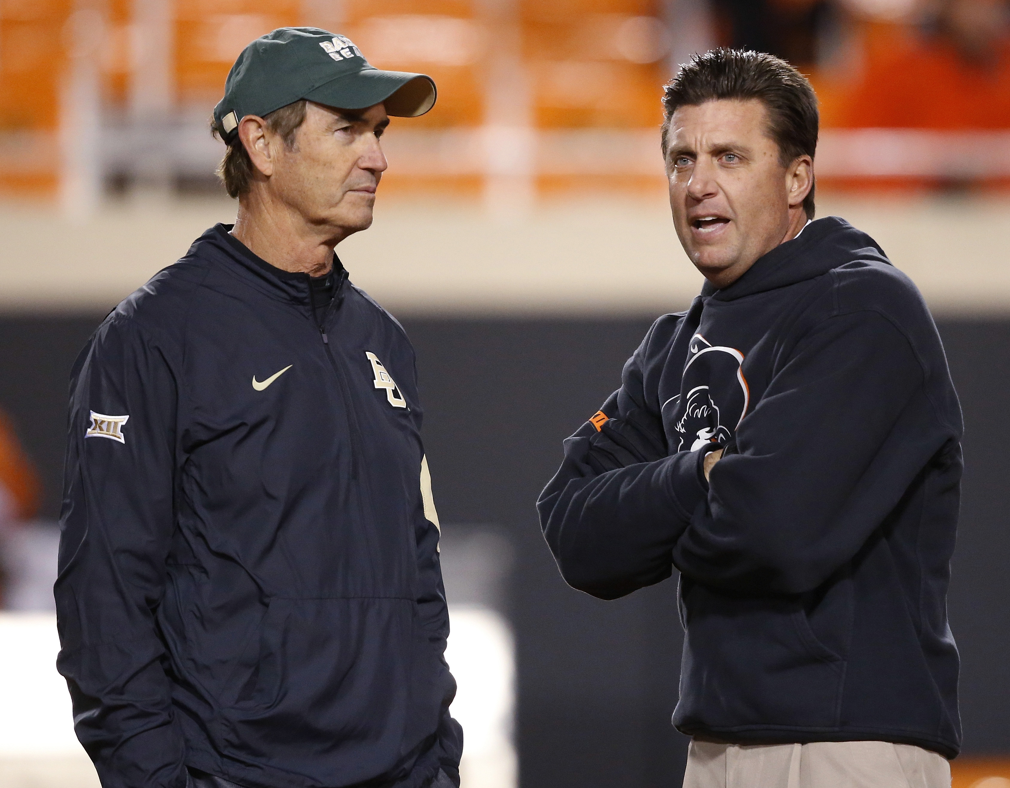 Baylor coach Art Briles, left, talks with Oklahoma State coach Mike Gundy before an NCAA college football game in Stillwater, Okla., Saturday, Nov. 21, 2015. (AP Photo/Sue Ogrocki)