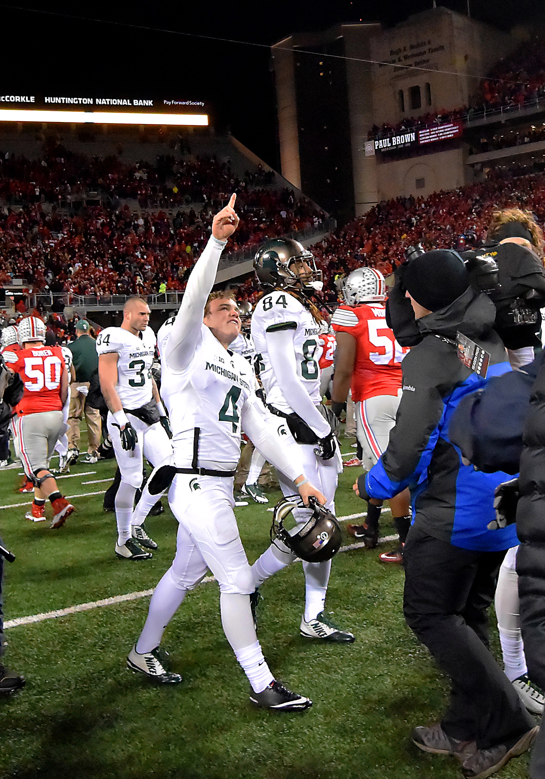 Michigan State kicker Michael Geiger (4) walks off the field in celebration after their 17-14 win over Ohio State in an NCAA college football game, Saturday, Nov. 21, 2015, in Columbus, Ohio. Geiger kicked the winning field goal as time expired in the gam
