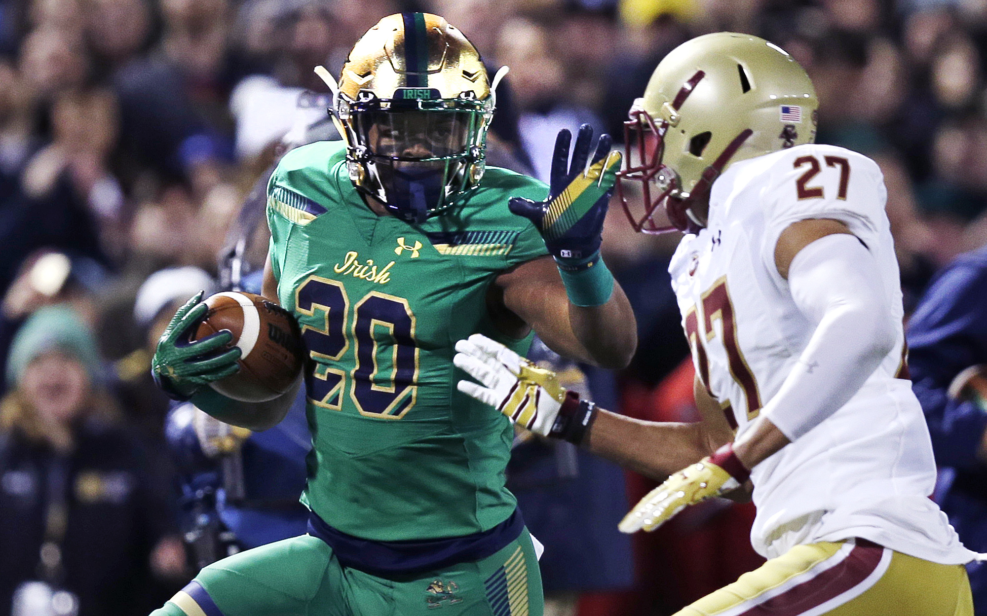Notre Dame running back C.J. Prosise (20) tries to elude Boston College defensive back Justin Simmons (27) on a drive during the first half of the Shamrock Series NCAA college football game at Fenway Park, home of the Boston Red Sox, in Boston, Saturday,
