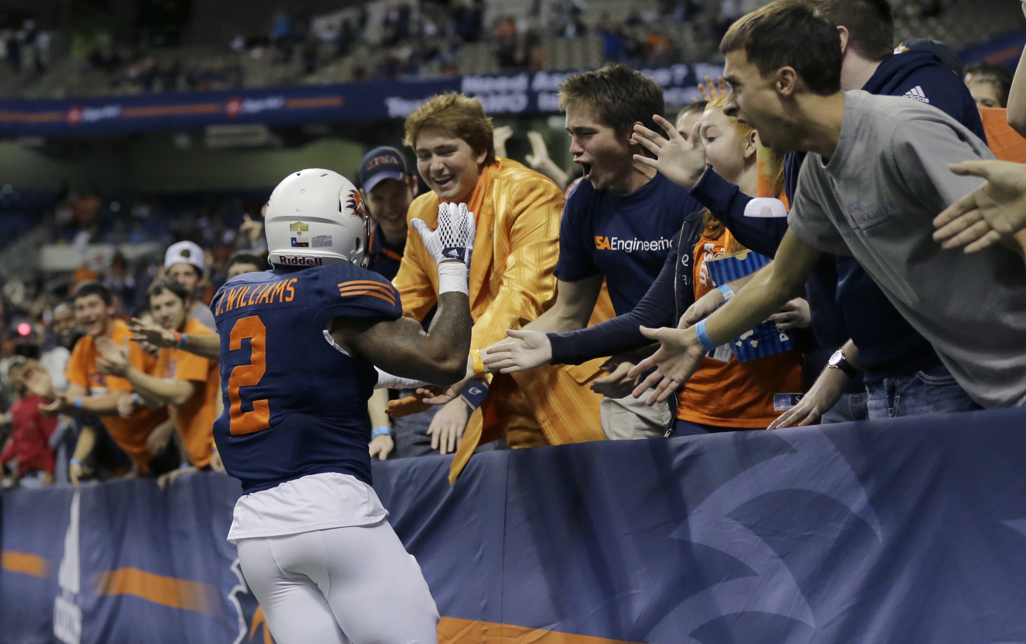 UTSA running back Jarveon Williams (2) celebrates with fans after he scored a touchdown against Rice during the first half of an NCAA college football game, Saturday, Nov. 21, 2015, in San Antonio. (AP Photo/Eric Gay)