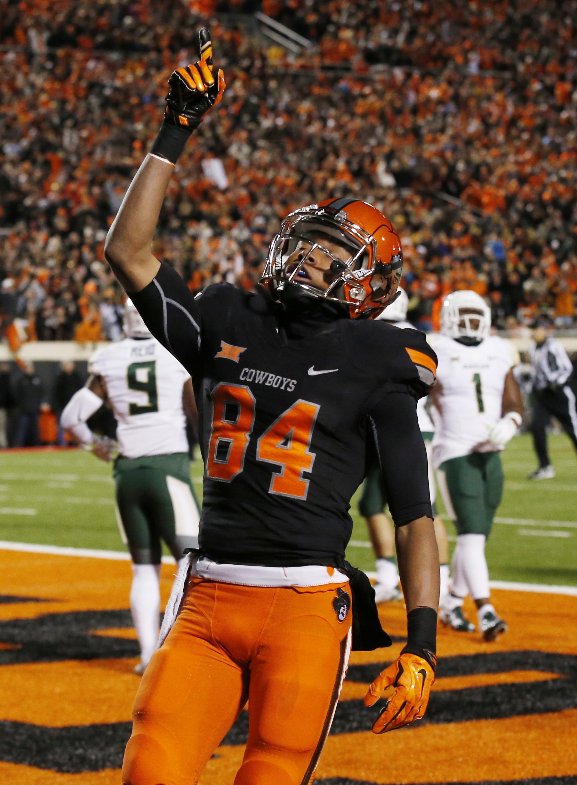 Oklahoma State wide receiver Jalen McCleskey (84) celebrates after scoring in the first quarter of an NCAA college football game against Baylor in Stillwater, Okla., Saturday, Nov. 21, 2015. (AP Photo/Sue Ogrocki)