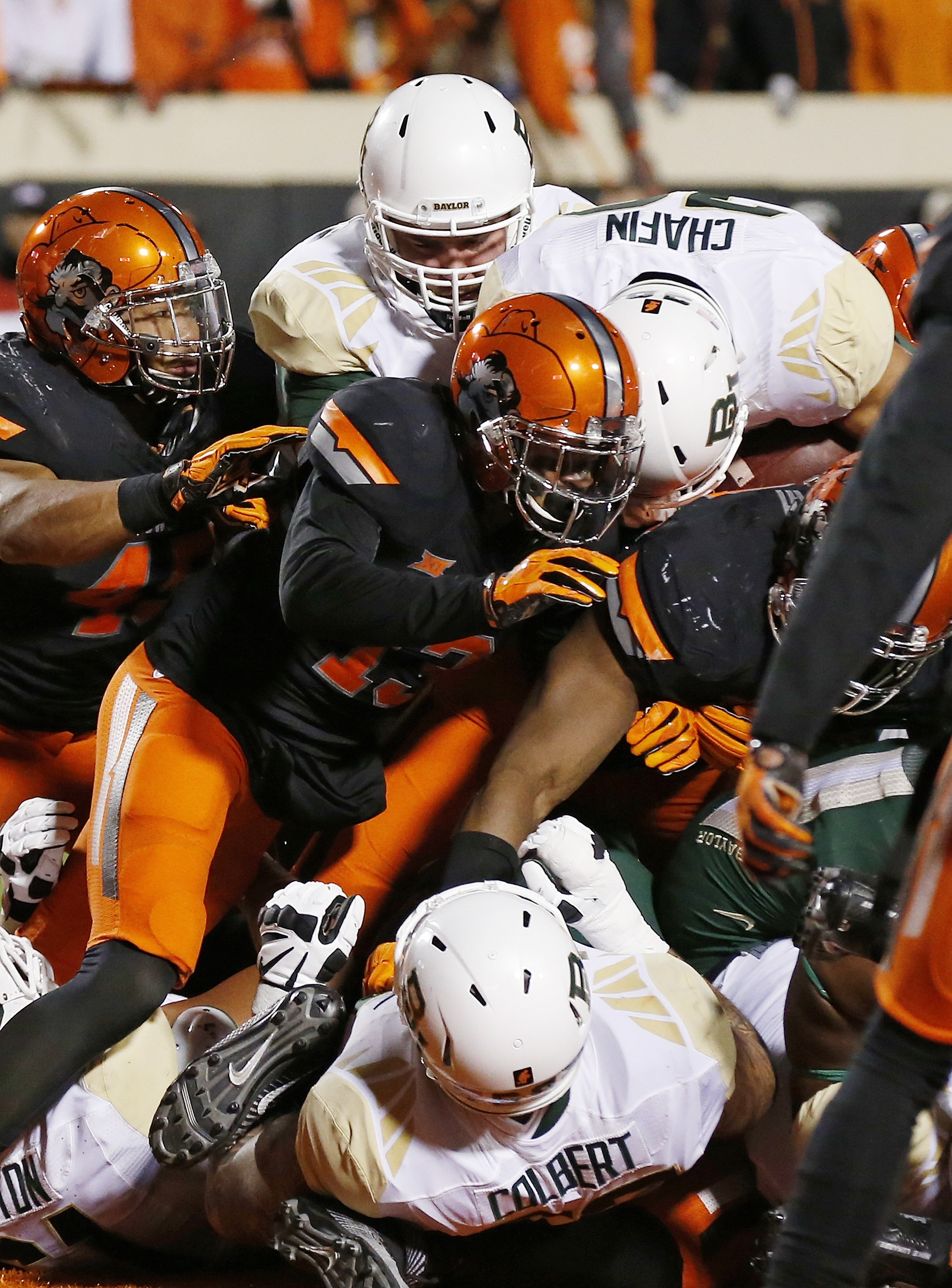Baylor running back Devin Chafin, top, scores behind Oklahoma State safety Jordan Sterns (13) during the second quarter of an NCAA college football game in Stillwater, Okla., Saturday, Nov. 21, 2015. (AP Photo/Sue Ogrocki)