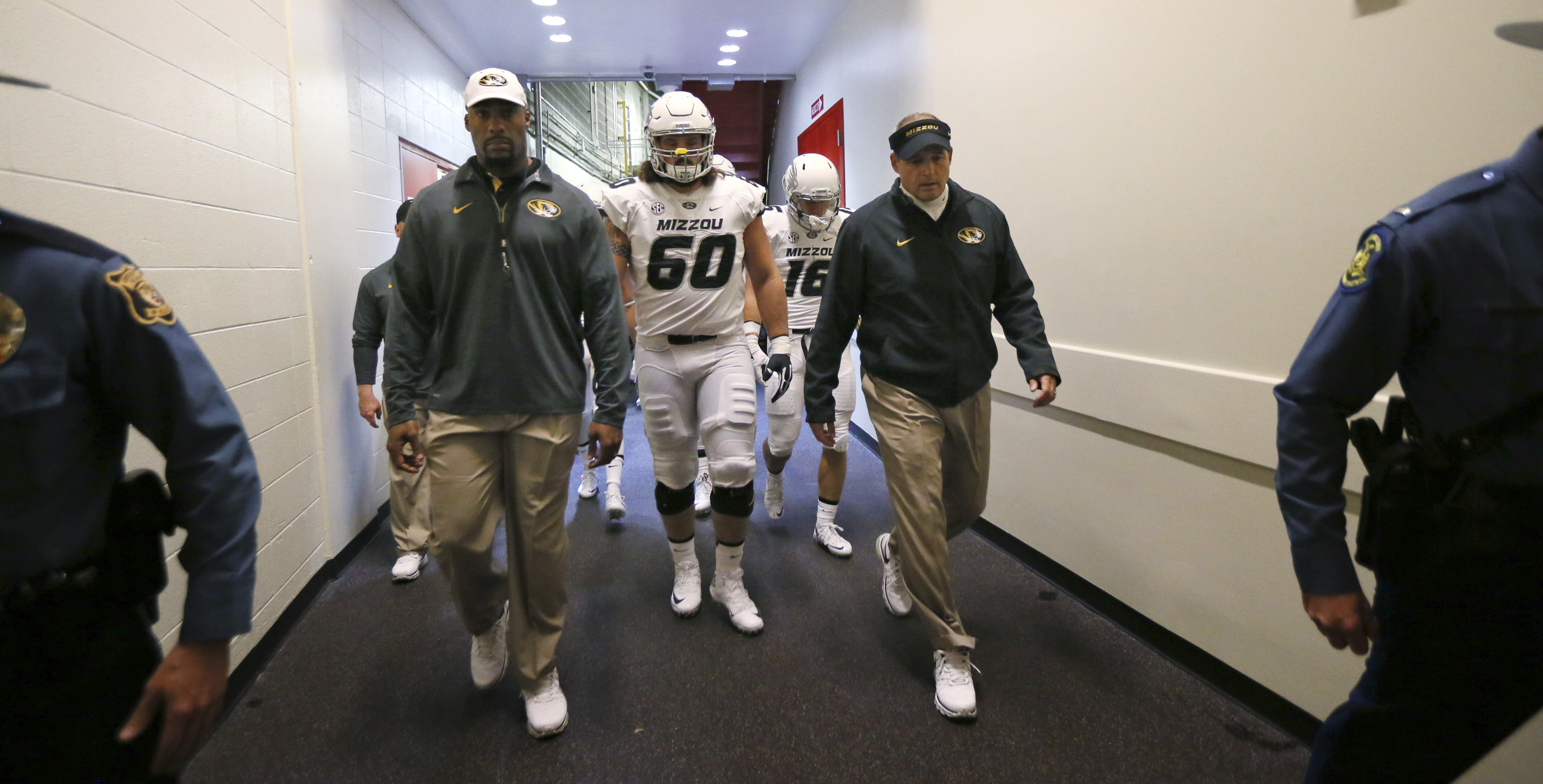 FILE - In this Saturday, Nov. 14, 2015, file photo, Missouri head coach Gary Pinkel, right, leads his players from the locker room to the field before an NCAA college football game between Missouri and BYU at Arrowhead Stadium in Kansas City, Mo. Pinkel s