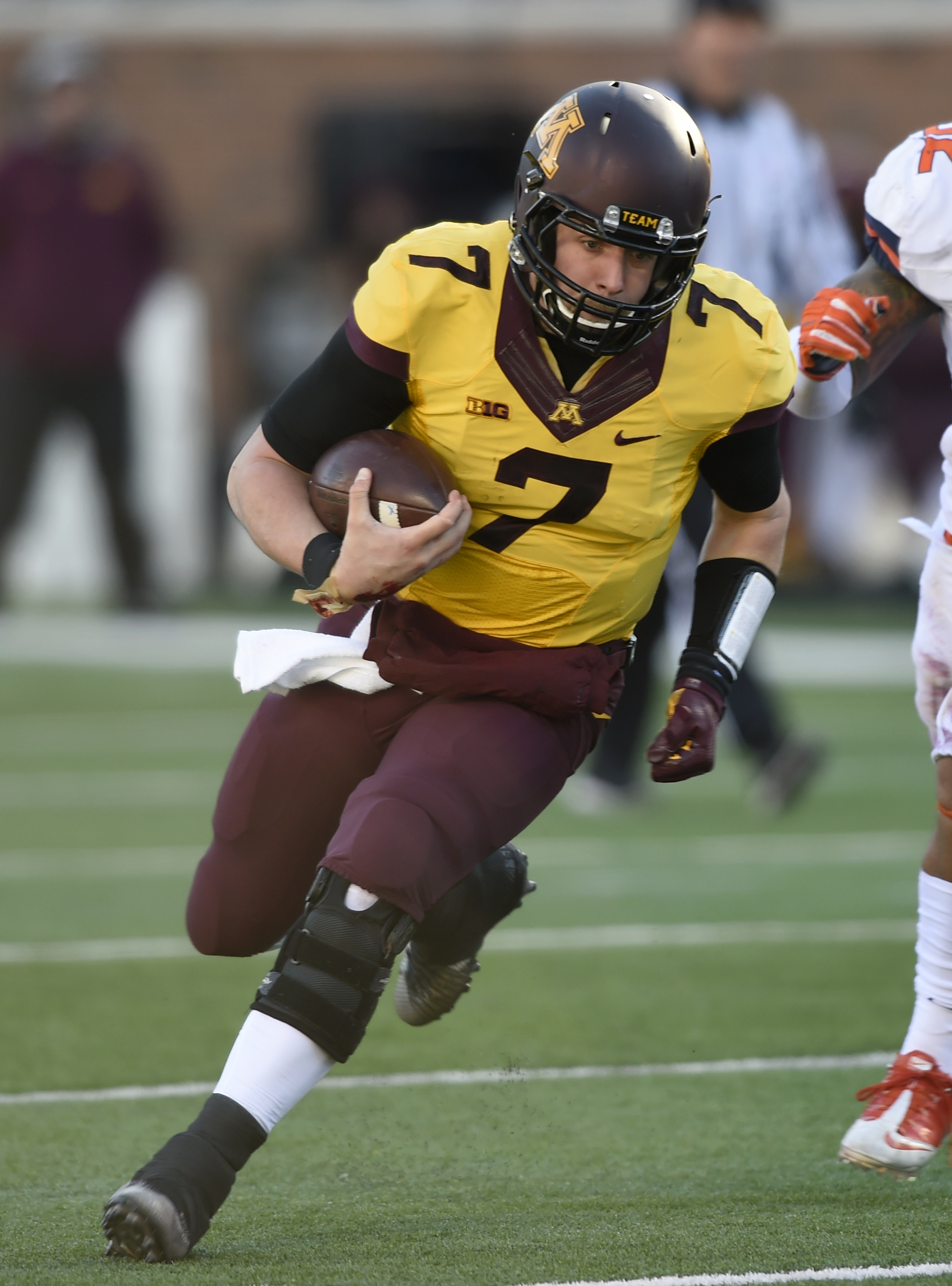 FILE - In this Nov. 21, 2015, file photo, Minnesota's quarterback Mitch Leidner (7) scrambles against Illinois in the first quarter during an NCAA college football game in Minneapolis. Paul Bunyan's Axe is on the line and bowl eligibility for the Gophers
