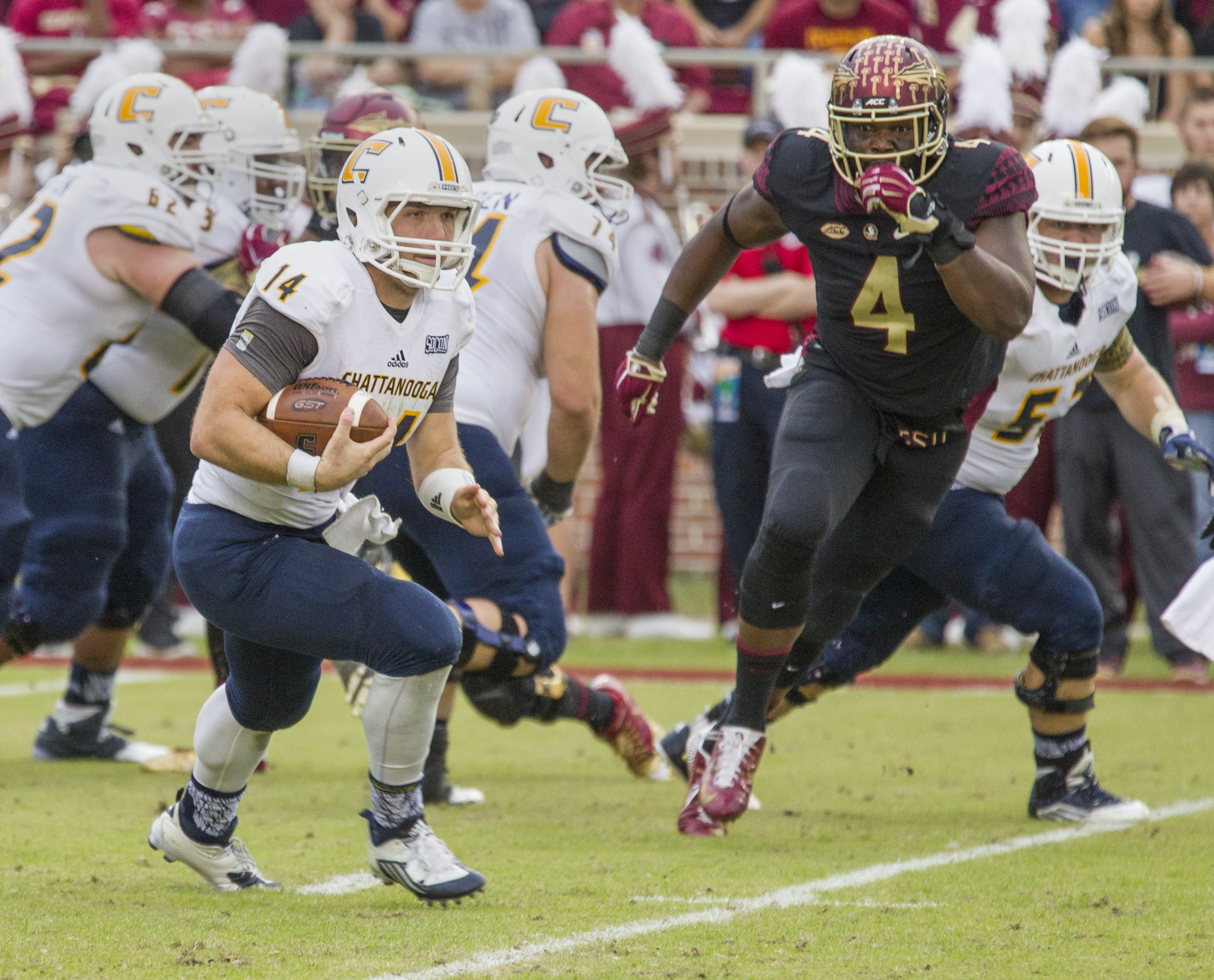 Chattanooga quarterback Jacob Huesman scrambles in the first half of an NCAA college football game in Tallahassee, Fla., Saturday, Nov. 21, 2015.  Florida State defeated Chattanooga 52-13.  (AP Photo/Mark Wallheiser)