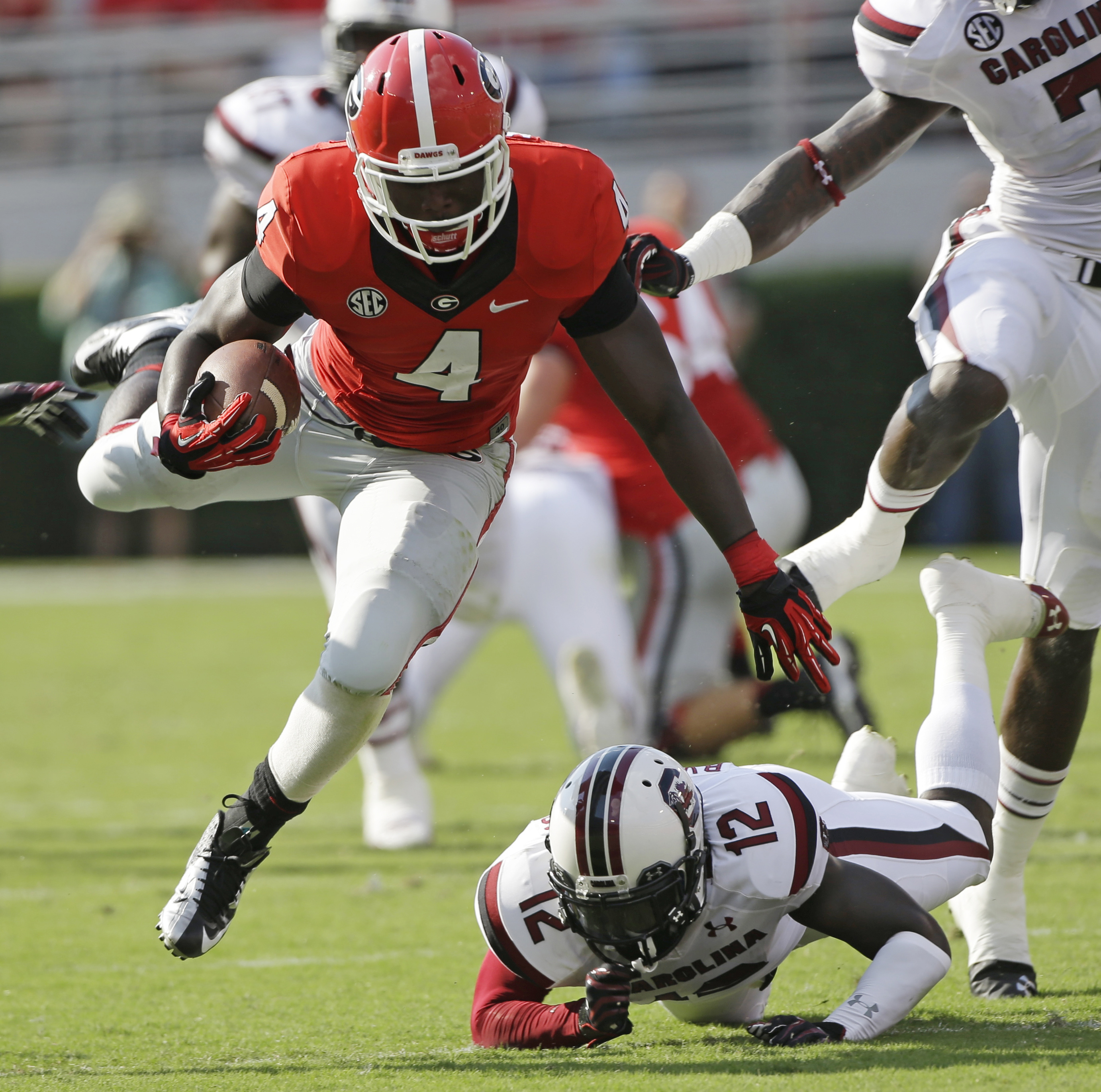 FILE - In this Saturday, Sept. 7, 2013,  file photo, Georgia running back Keith Marshall (4) gets by South Carolina safety Brison Williams (12) during the first half of an NCAA football game in Athens, Ga. Keith Marshall of Georgia and Marcus Marshall of