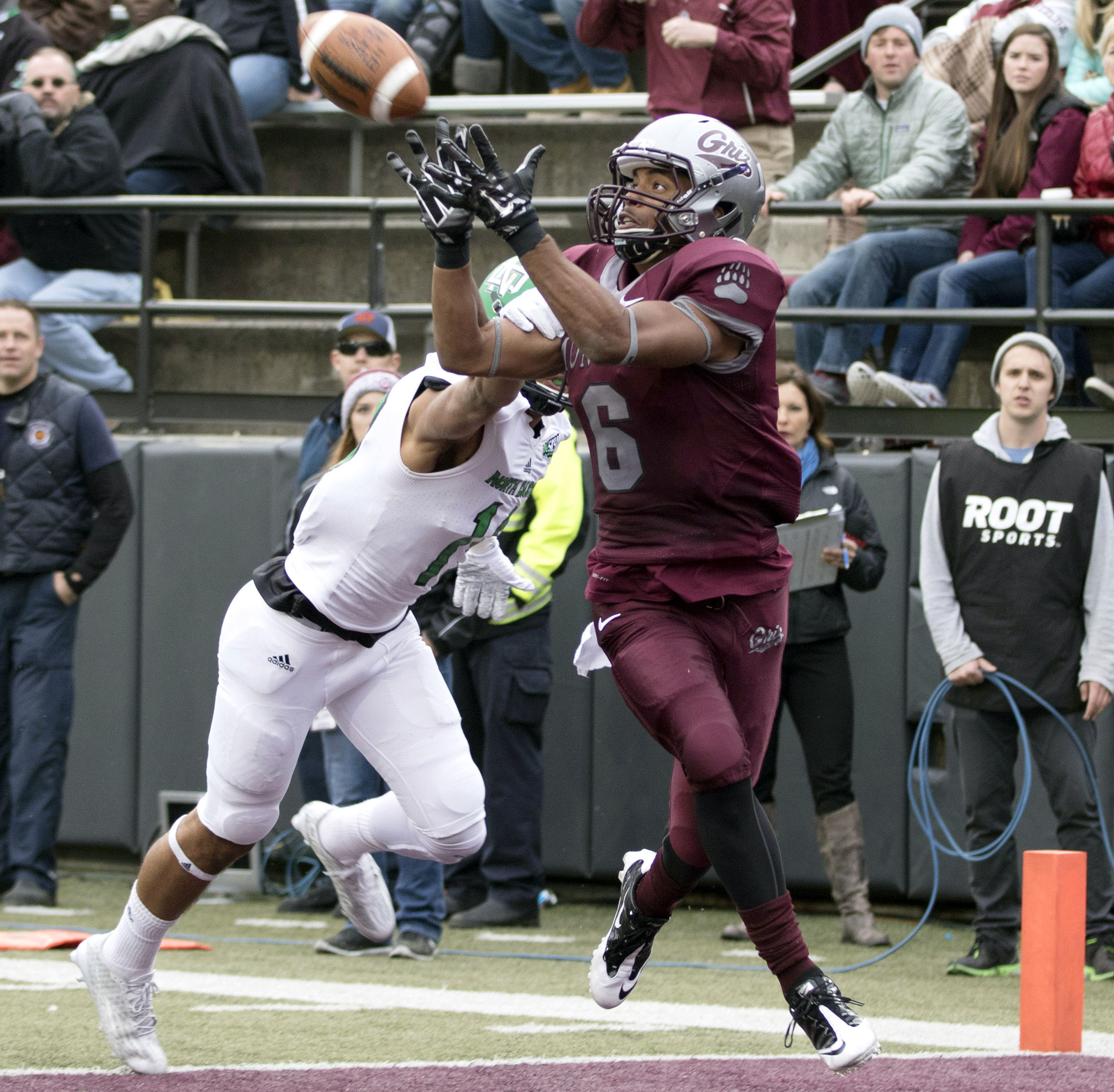 FILE - In this Oct. 24, 2015, file photo, Montana wide receiver Jamaal Jones (6) catches a touchdown pass against North Dakota during an NCAA college football game in Missoula, Mont. South Dakota State plays Montana on Saturday, Nov. 28. (AP Photo/Patrick