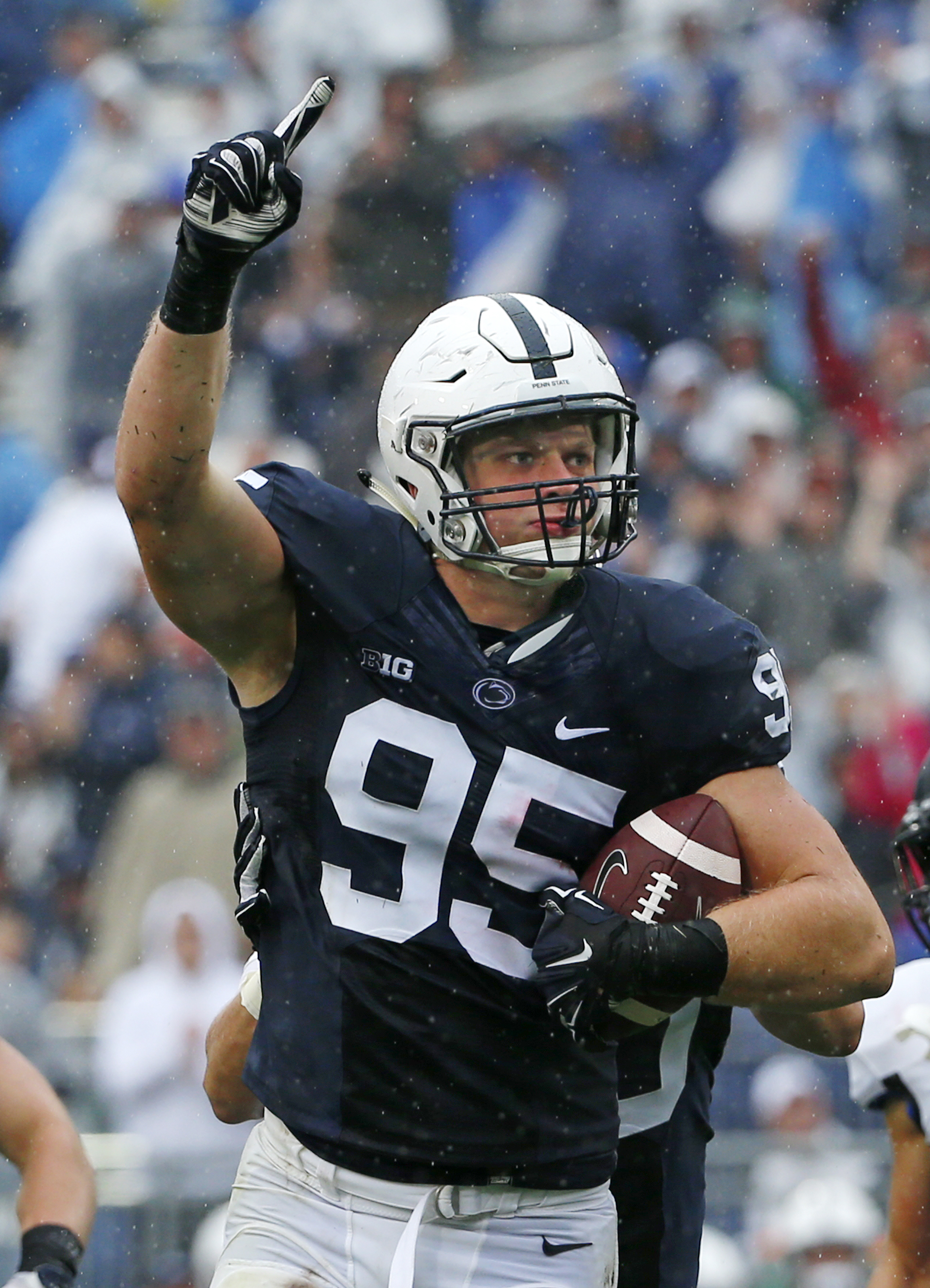 FILE - In this Sept. 12, 2015, file photo, Penn State defensive end Carl Nassib celebrates his interception during an NCAA college football game against Buffalo in State College, Pa. Nassib was hurt in a game at Northwestern three weeks ago. He played the